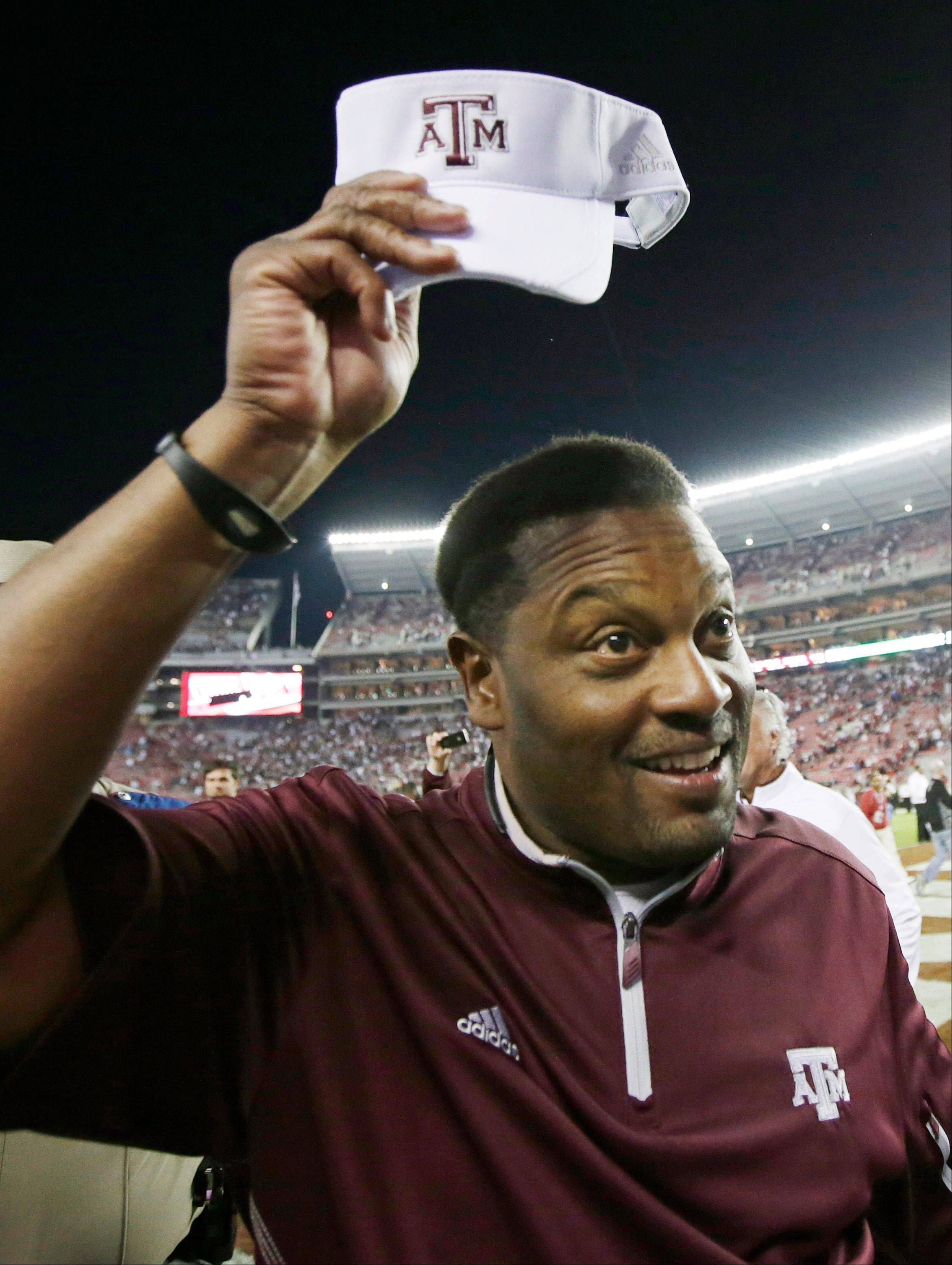 Texas A&M coach Kevin Sumlin tips his cap following a 29-24 win over top ranked Alabama in Tuscaloosa on Saturday.
