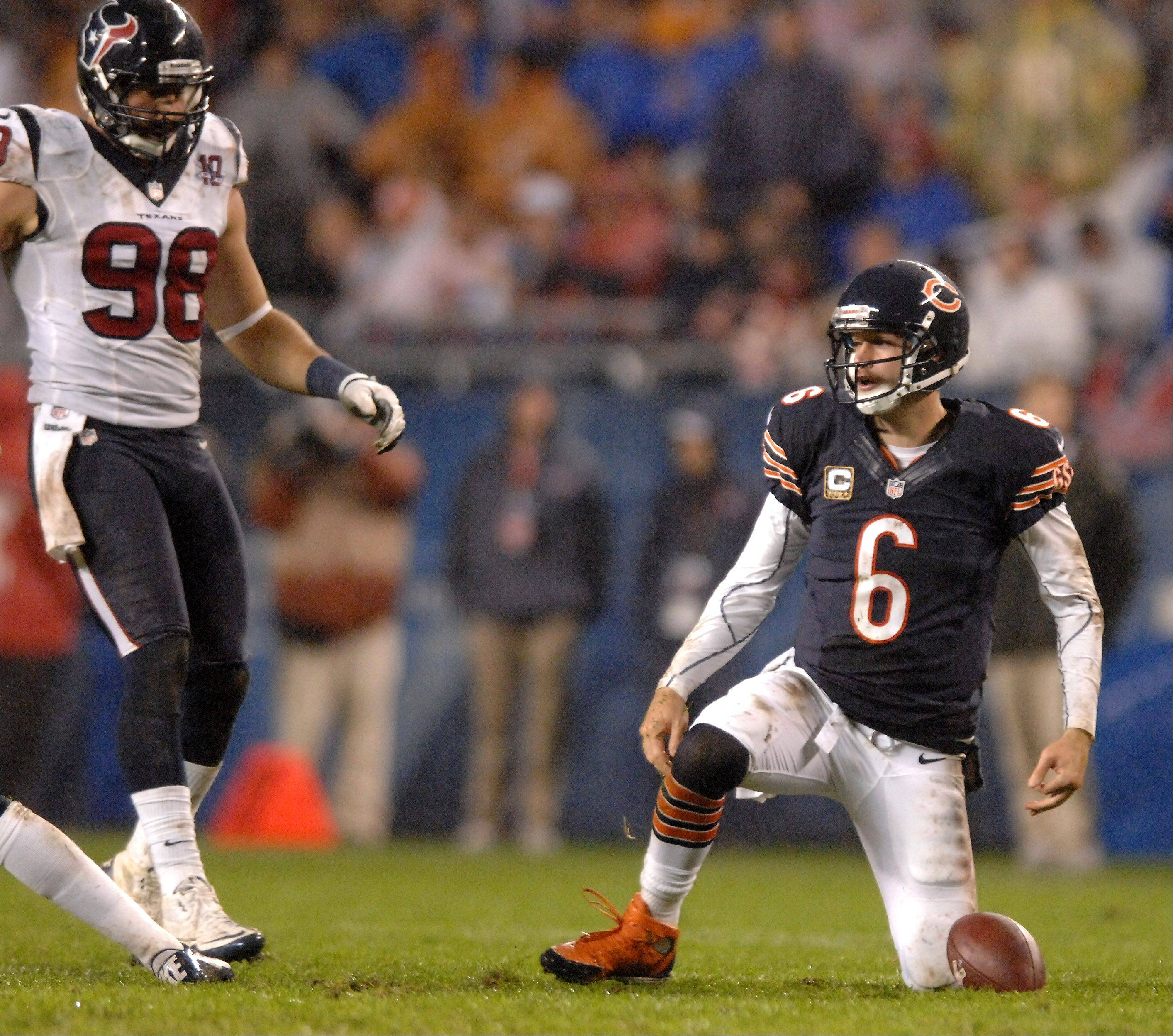 Chicago Bears quarterback Jay Cutler (6) gets up after a second quarter hit that may have resulted in a concussion during Sunday's game at Soldier Field in Chicago. Cutler did not return to the game in the second half.