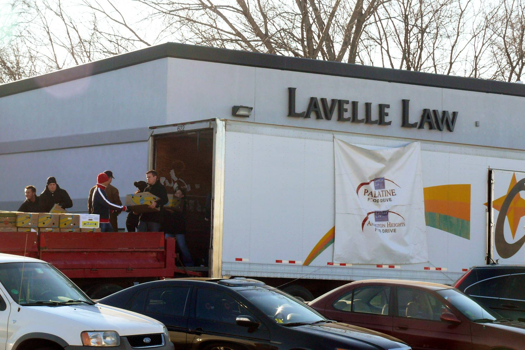 The staff and attorneys of Lavelle Law, Ltd and other volunteers will deliver the proceeds of the 9th annual Palatine Food Drive to the Palatine Township Food Pantry on November 20th.