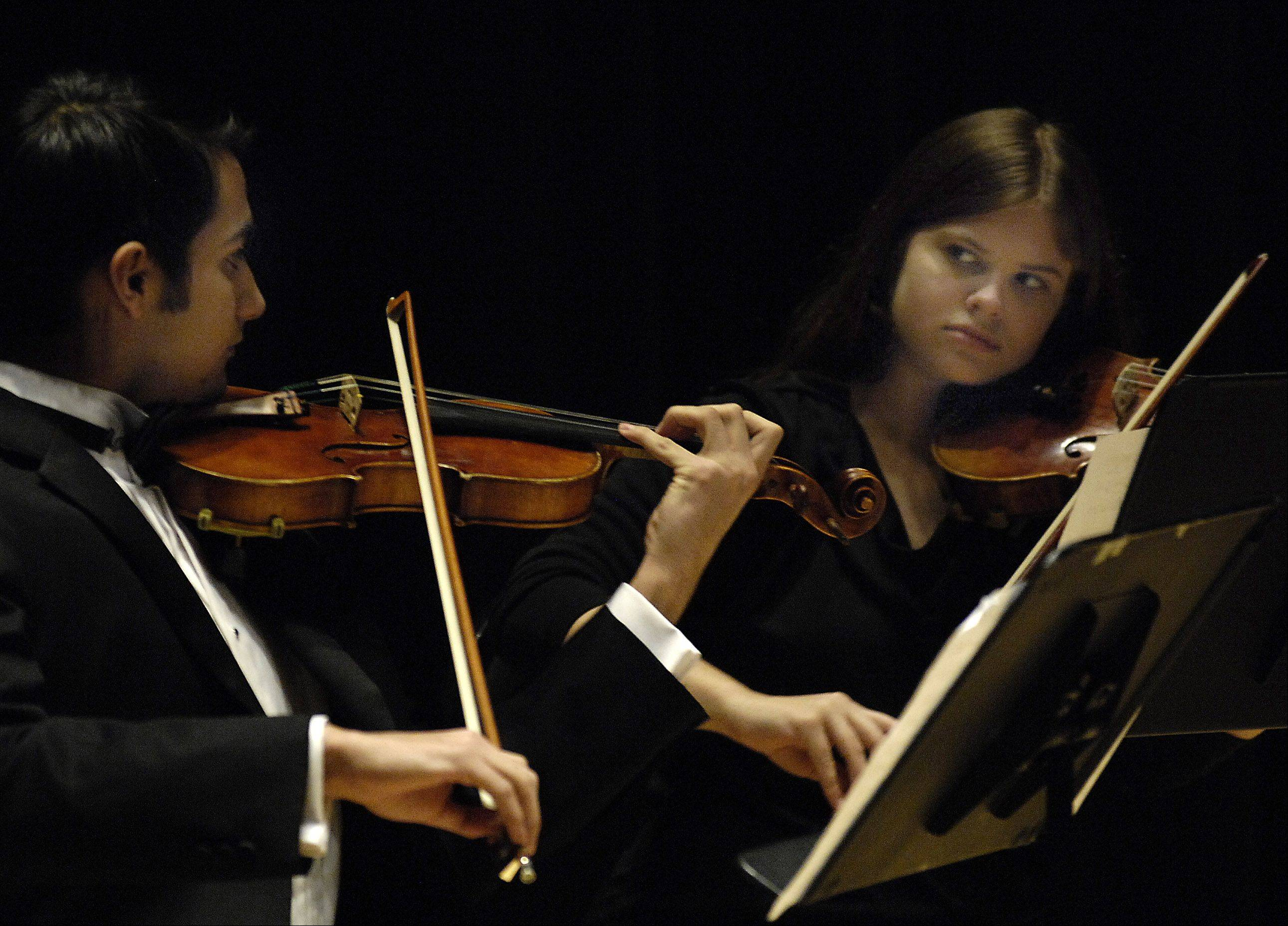 From left, Michael Arias and Julia Heeren perform during a previous Elgin Youth Symphony Orchestras concert. This Sunday, Nov. 18, EYSO musicians will perform free Chamber Music Institute Concerts at Elgin Community College.