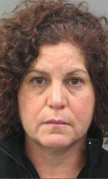Retired Barrington High administrator charged with theft