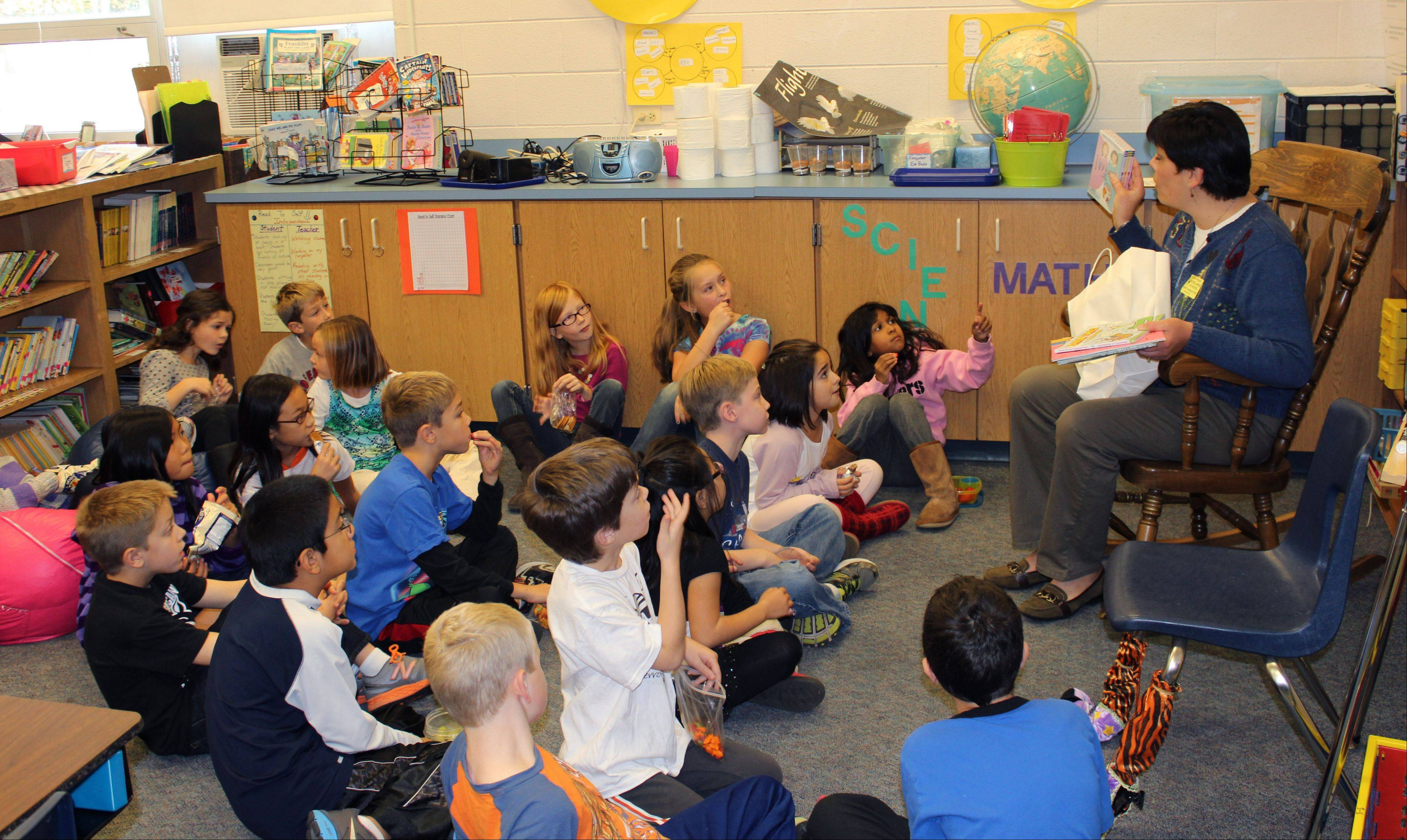 Jane Risley reads to Rockland School students as part of Libertyville Sunrise Rotary Club�s �Rotary Reads� program.