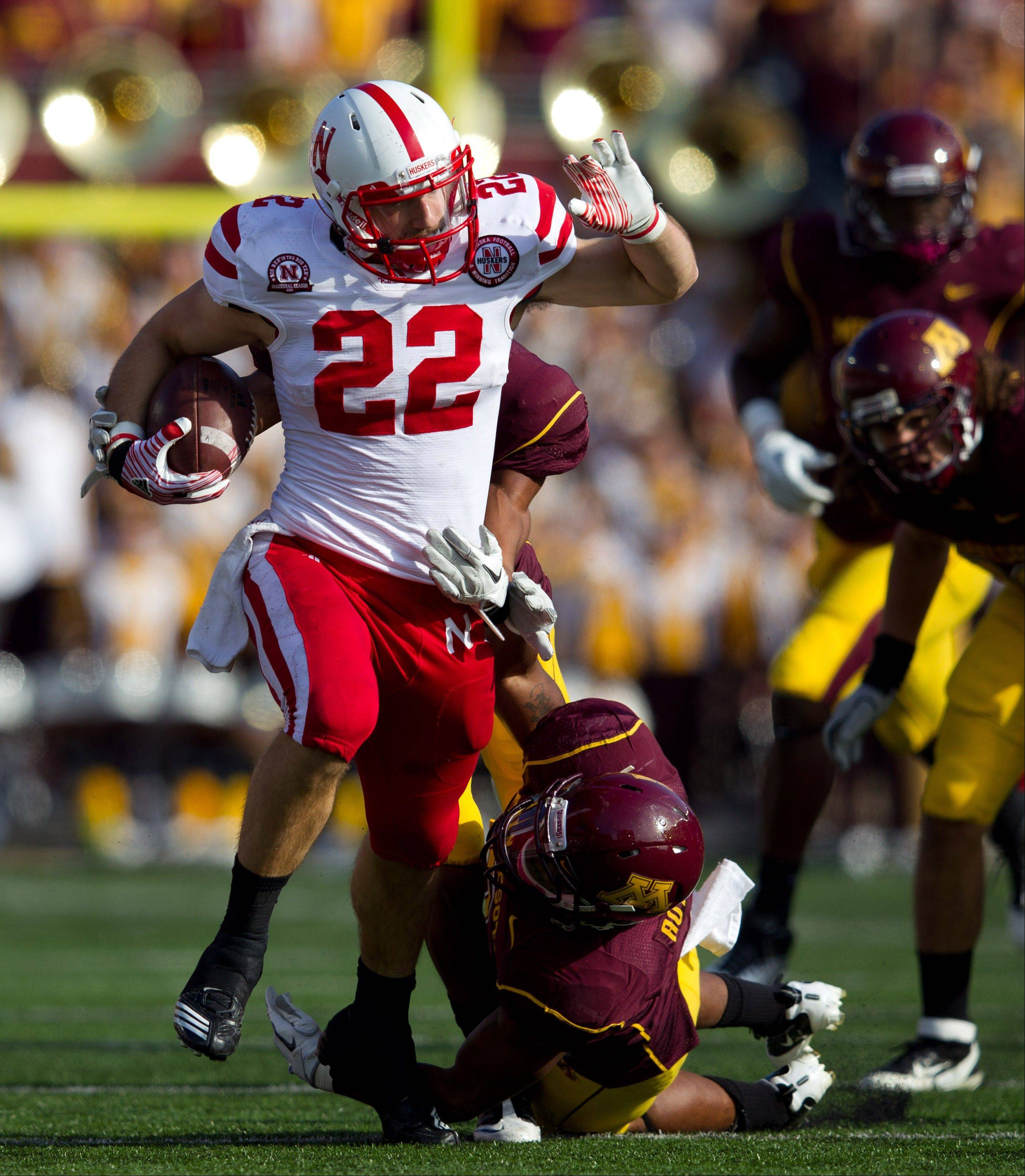 Nebraska running brack Rex Burkhead rumbles through the Minnesota defense as Gopher defender Kim Royston makes the tackle in Minneapolis. Burkhead injured his knee in the Huskers� first game and has missed five games this season and left early three other games.
