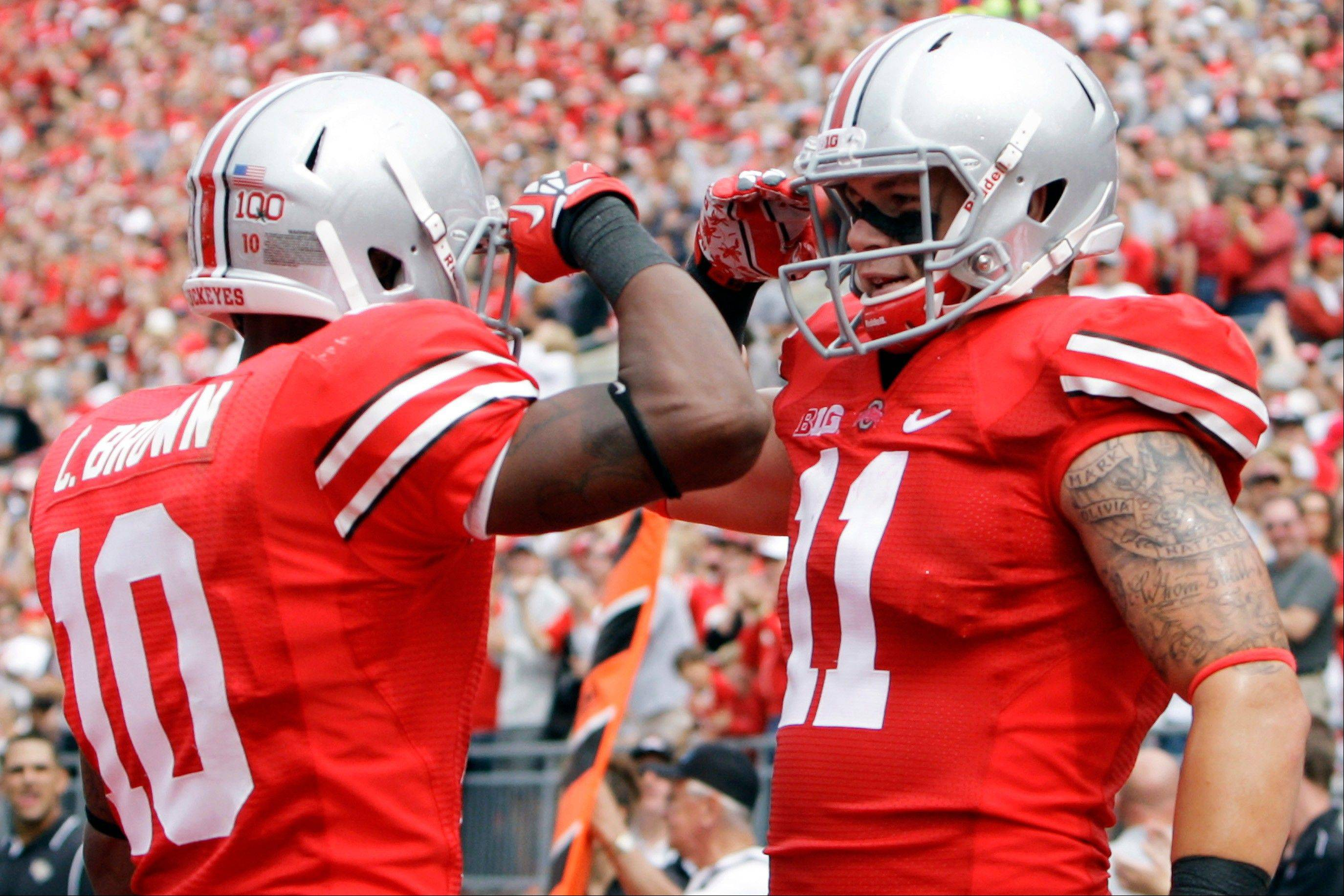 Ohio State�s Jake Stoneburner, right, celebrates his touchdown against Central Florida with Corey Brown. The Buckeyes face Wisconsin this Saturday. �I don�t want to go on record saying that I hate Wisconsin more than Michigan,� Brown said, �but I hate Wisconsin just as much as Michigan.�