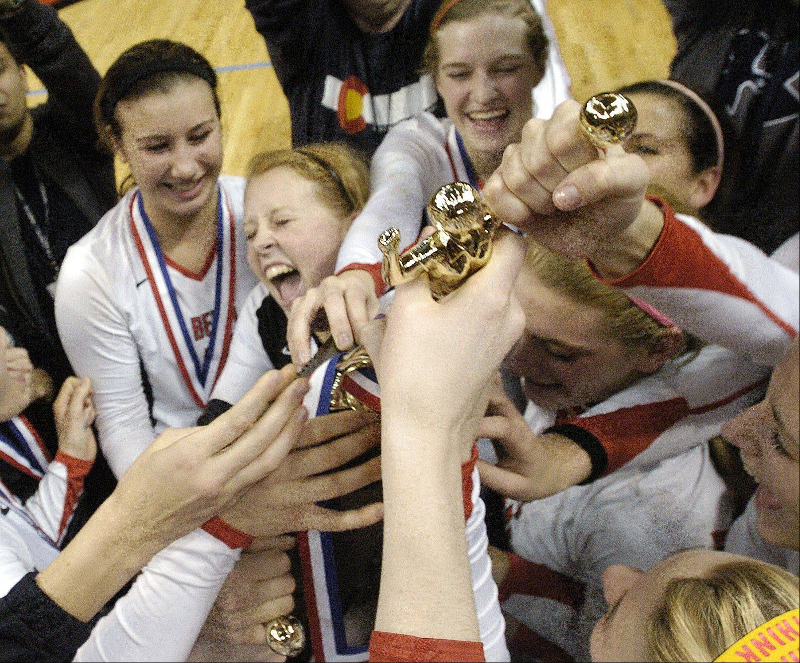 Benet celebrates their big win during the Class 4A girls volleyball championship game against New Trier Saturday.