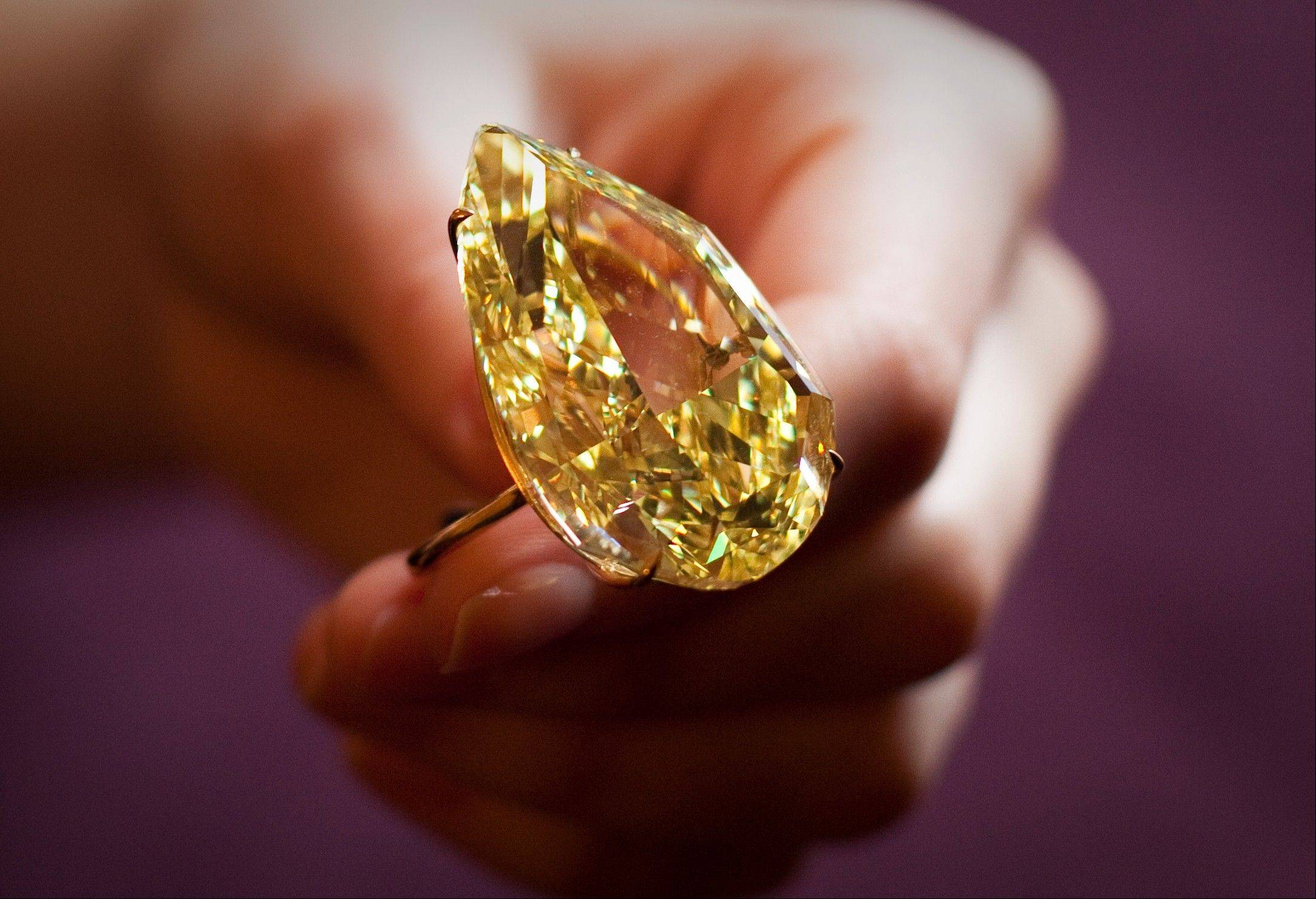 A 110.03 carats Sun-Drop Diamond described as fancy vivid yellow, the highest color grading by gemstone experts at a Sotheby's preview show in Geneva, Switzerland.