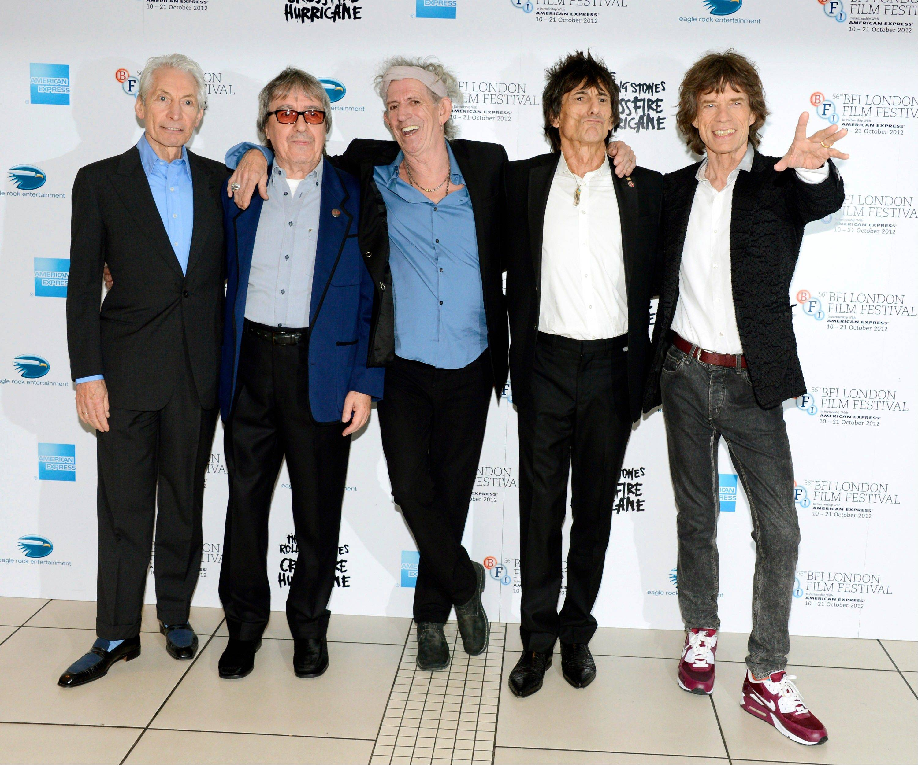 Charlie Watts, left, Bill Wyman, Keith Richards, Ronnie Wood and Mick Jagger of The Rolling Stones, who are set for five concerts in London and the New York area over the next month, released another hits compilation with two new songs on Tuesday, Nov. 13.