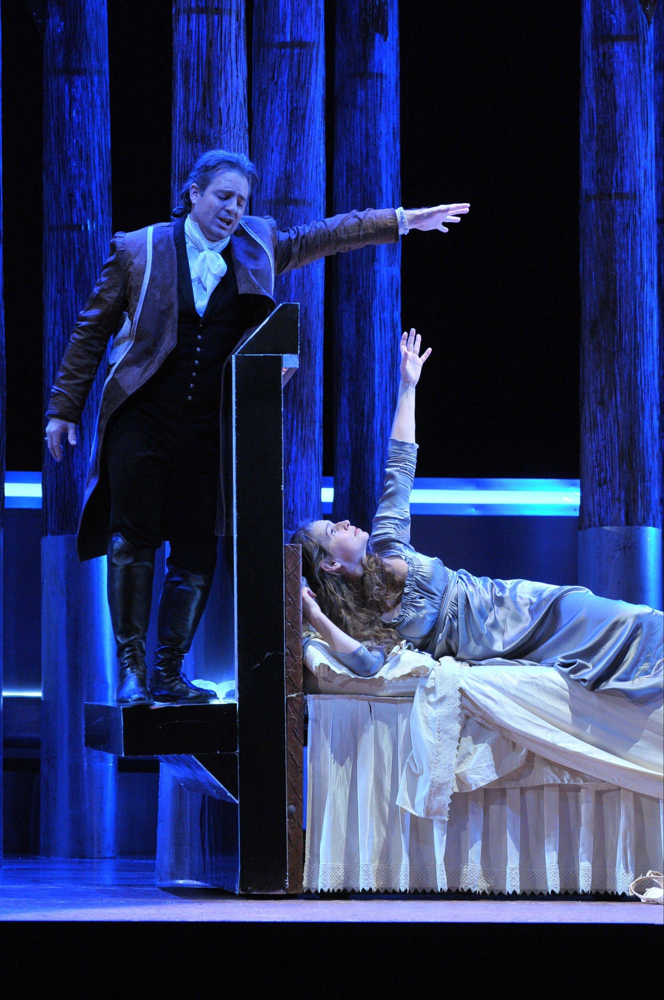 "Werther (Wilmette native Matthew Polenzani) haunts the dreams of Charlotte (Sophie Koch) in director Francisco Negrin's interpretation of Massenet's ""Werther"" for the Lyric Opera of Chicago. The new coproduction with San Francisco Opera runs through Monday, Nov. 26."