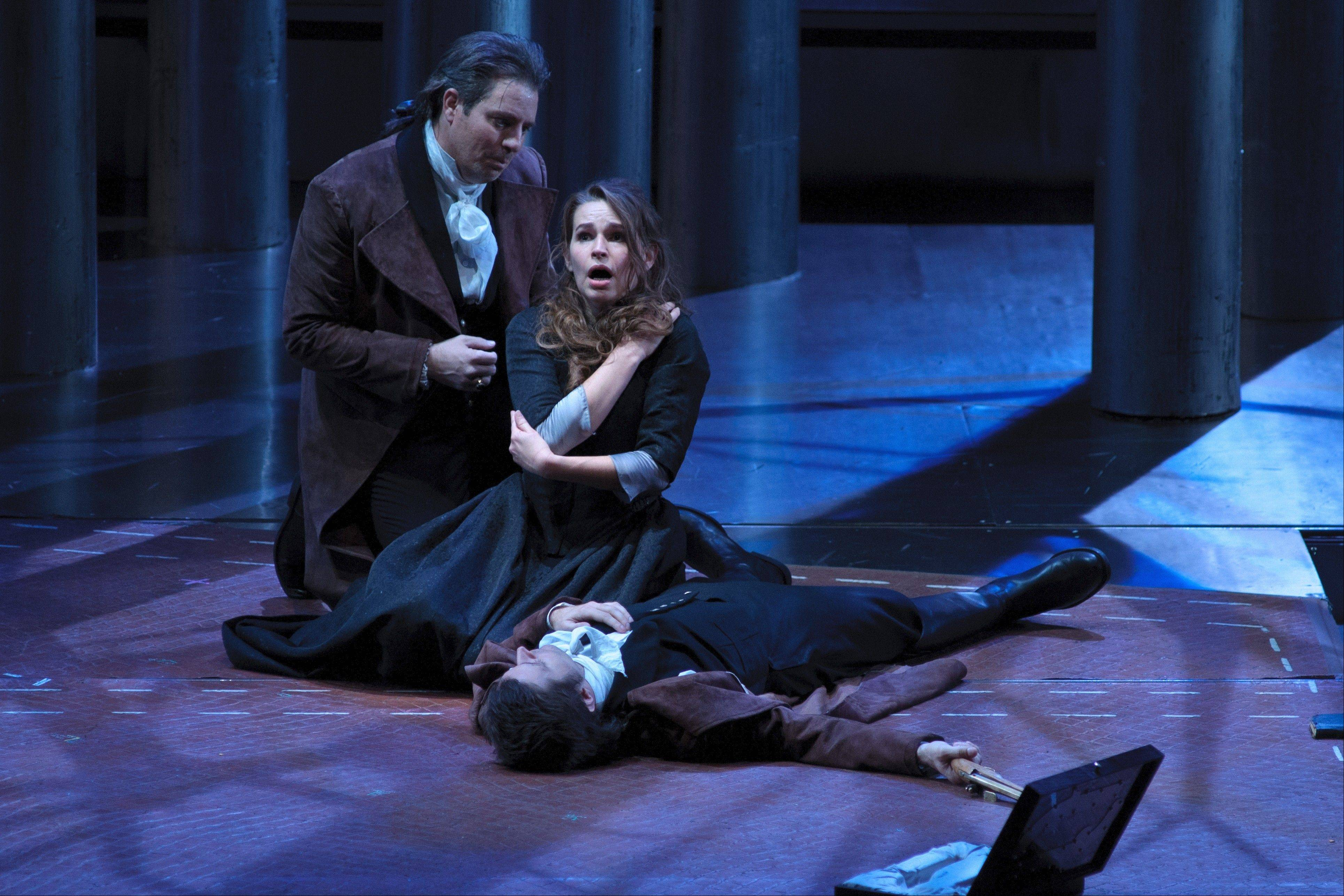 "A possible spirit of Werther (Wilmette native Matthew Polenzani) comforts Charlotte (Sophie Koch) after his suicide in director Francisco Negrin's interpretation of Massenet's ""Werther"" for the Lyric Opera of Chicago. The new coproduction with San Francisco Opera runs through Monday, Nov. 26."