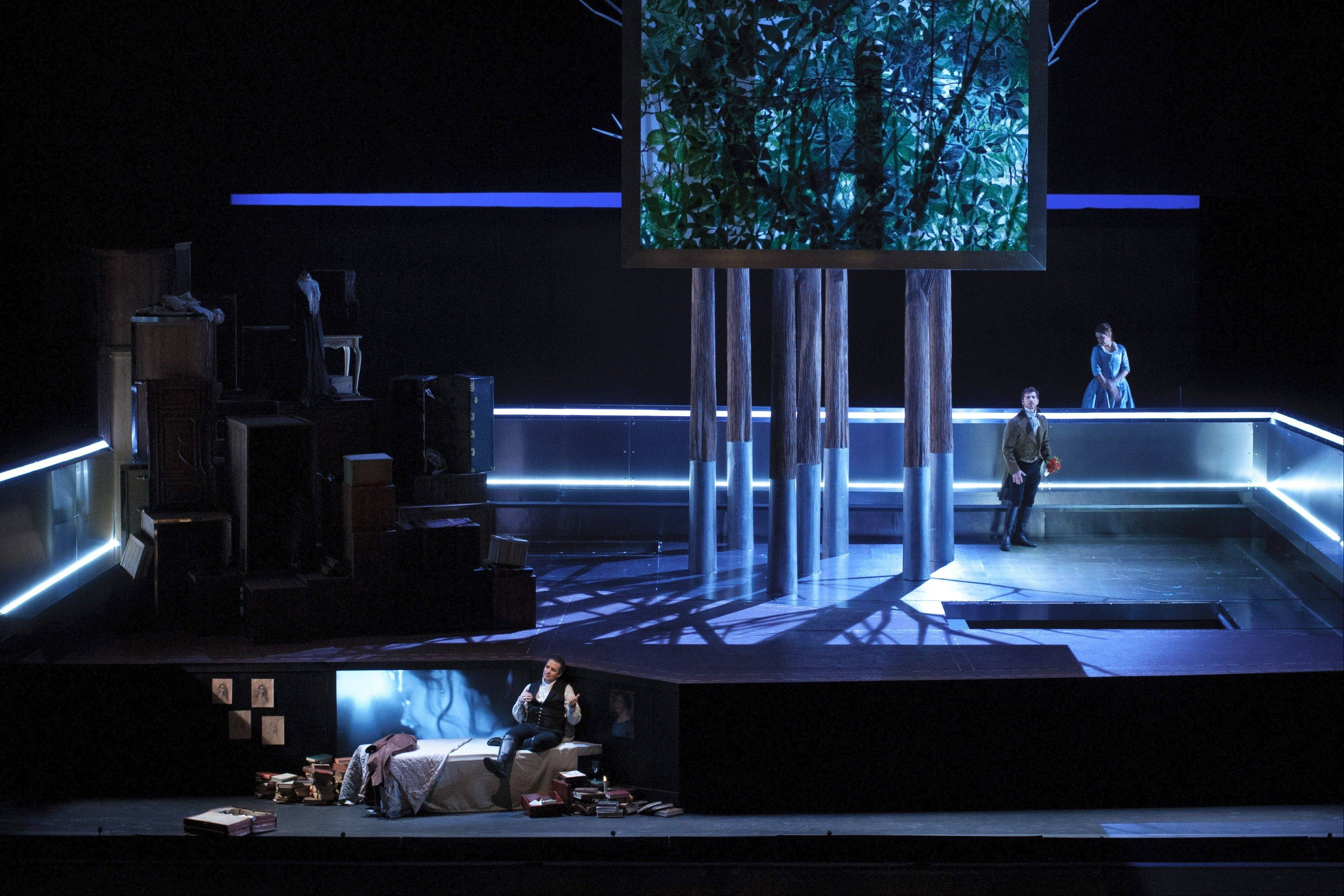 "An enveloping stainless steel bench and period costumes are a feature of the set and costume designs by Louis Désiré in director Francisco Negrin's interpretation of Massenet's ""Werther"" for the Lyric Opera of Chicago."