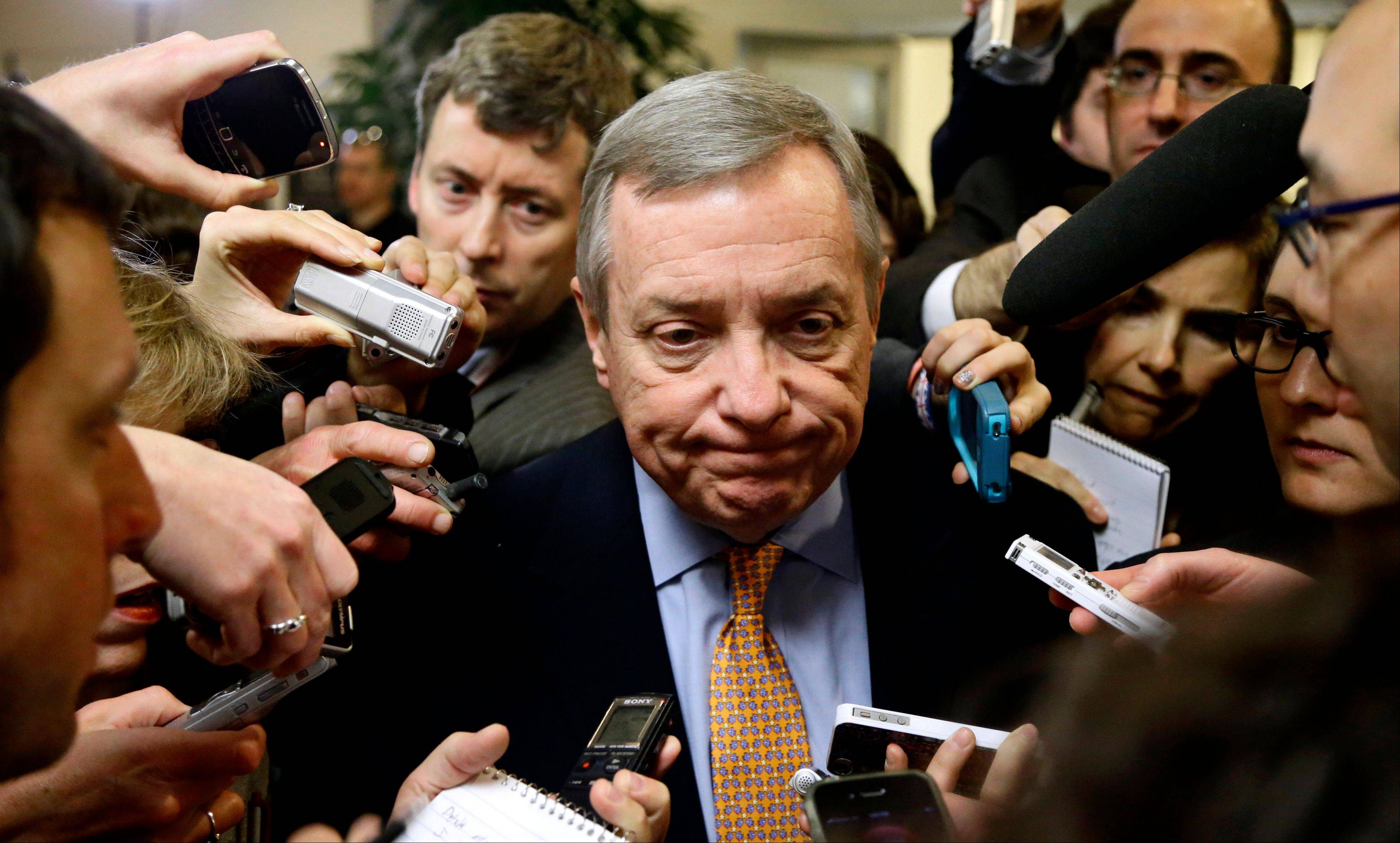 Senate Majority Whip Richard Durbin of Illinois speaks to reporters on Capitol Hill Tuesday, as the lame duck 112th Congress returned.