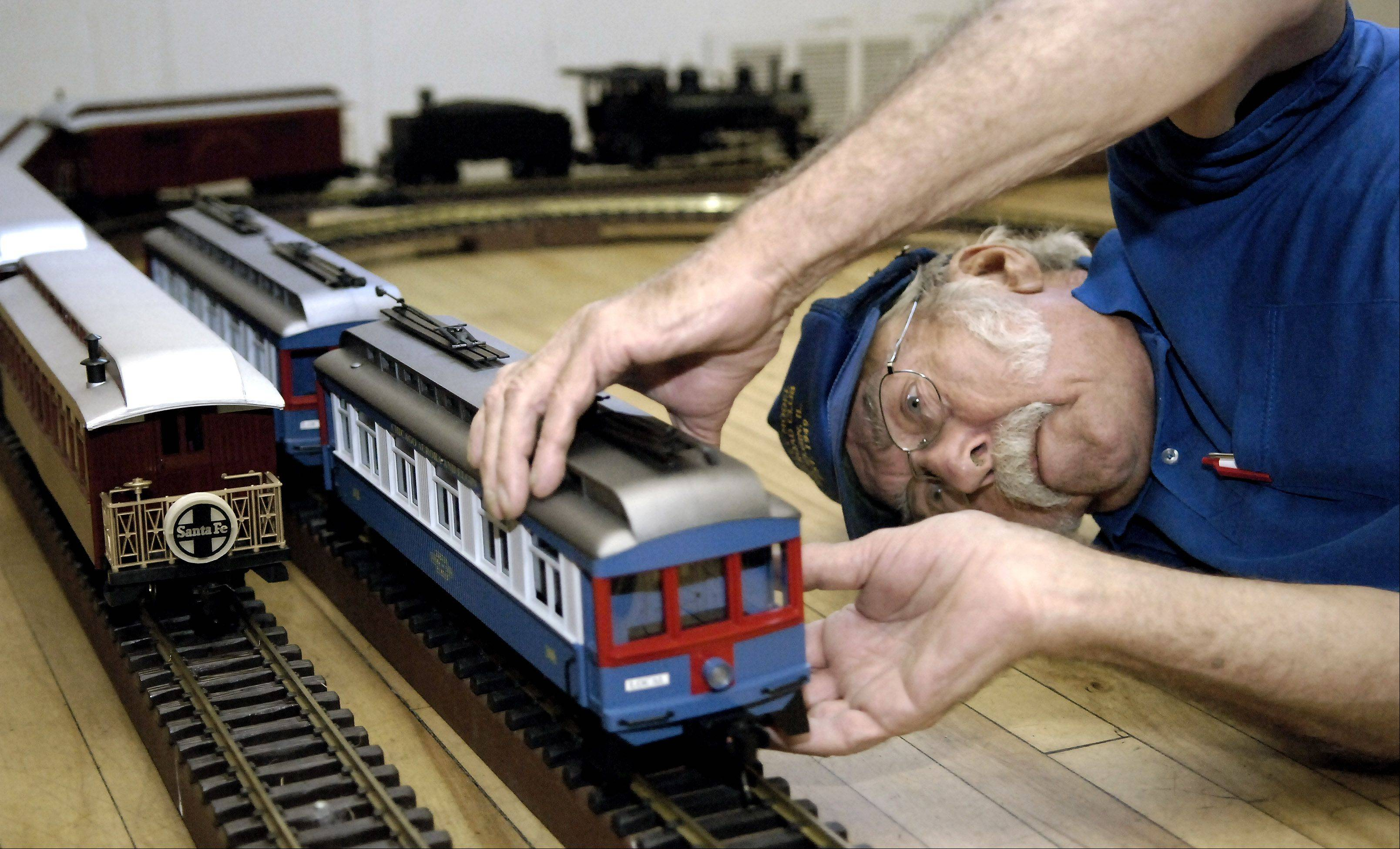 Wally Schalk of Elmhurst and a member of the Valley Model Railroad Club of South Elgin puts replica cars from the Chicago, Aurora & Elgin Railway on a track inside the St. Charles VFW Hall on Third St., for the 2007 Scarecrow Festival. Schalk and fellow club members brought several train cars from their personal collections for the display.