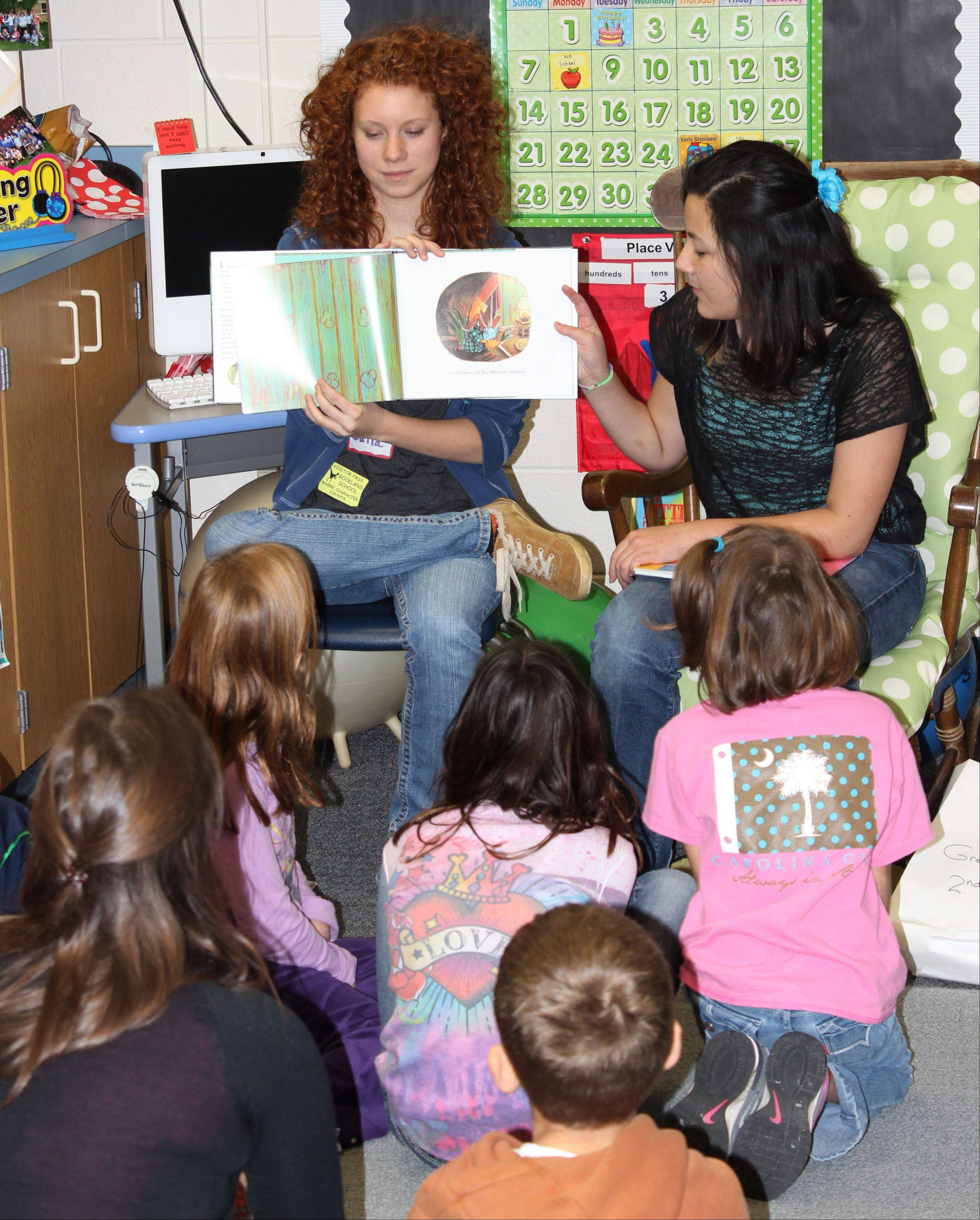 Libertyville High School INTERACT Club students read to Rockland School students.
