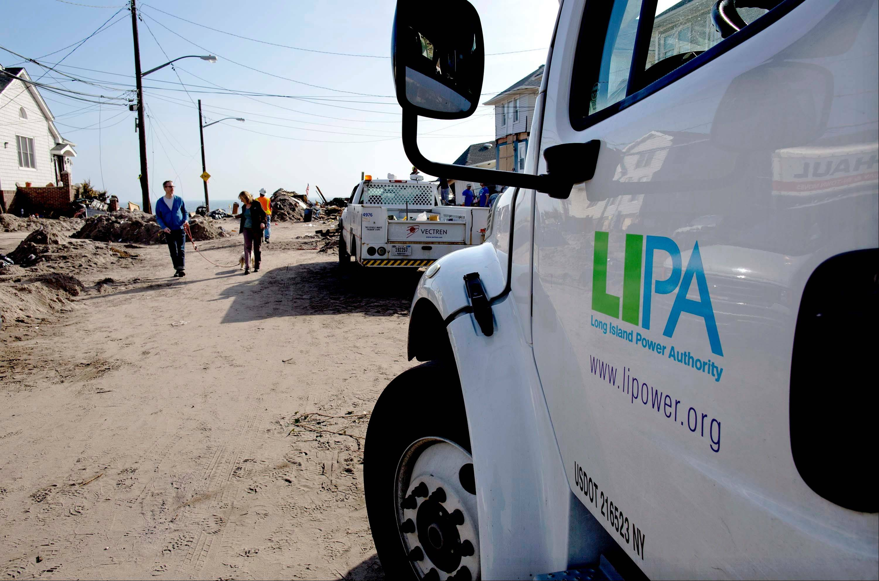 A Long Island Power Authority (LIPA) truck is seen in the Belle Harbor neighborhood of the borough of Queens, New York, Monday, Nov. 12, 2012, in the wake of Superstorm Sandy.