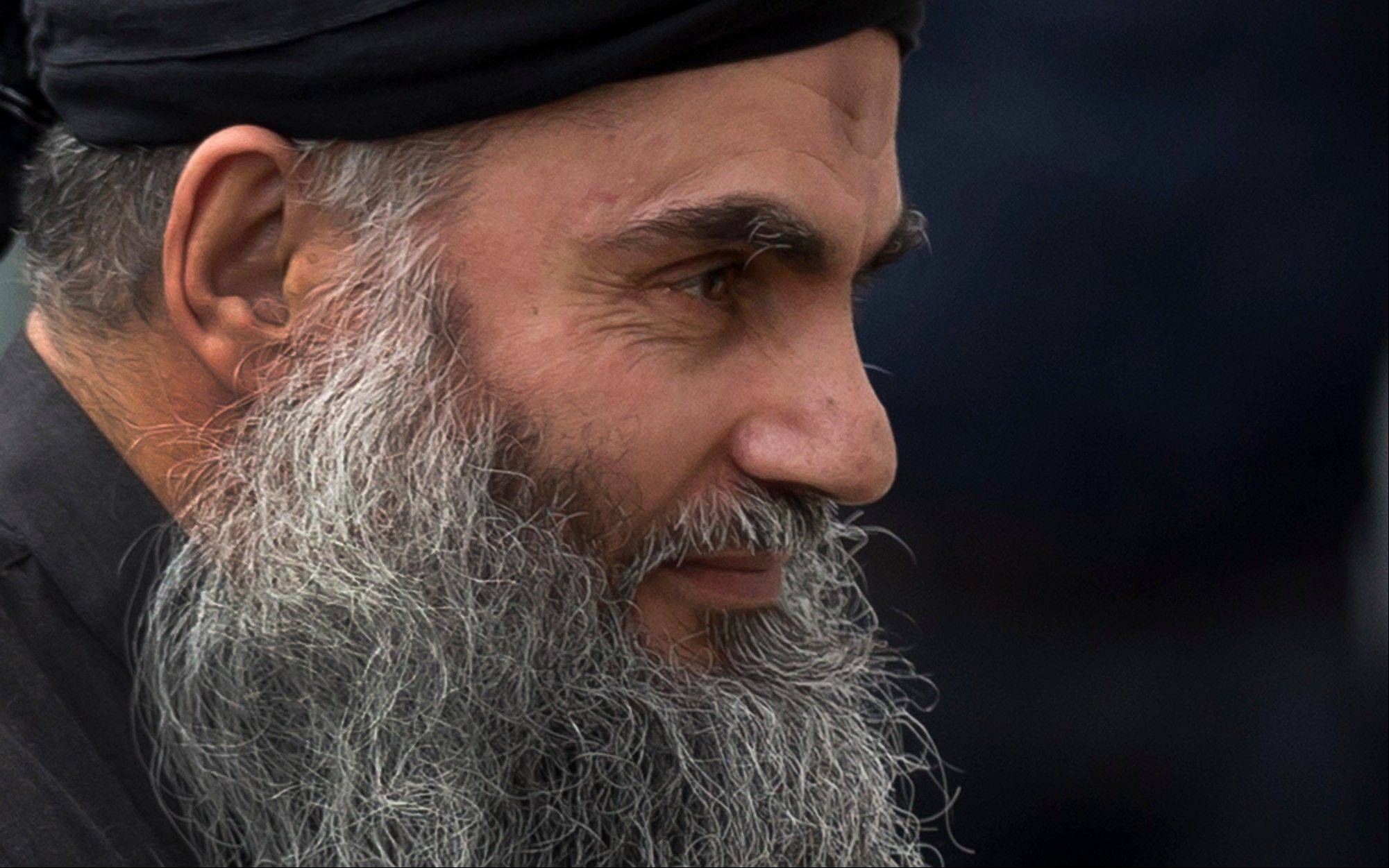 Abu Qatada arrives back at his residence in London after being freed from prison, Tuesday, Nov. 13, 2012. The radical Islamist cleric described by prosecutors as a key al-Qaida operative in Europe was freed from prison Tuesday after a court ruled he cannot be deported from Britain to Jordan to face terrorism charges.