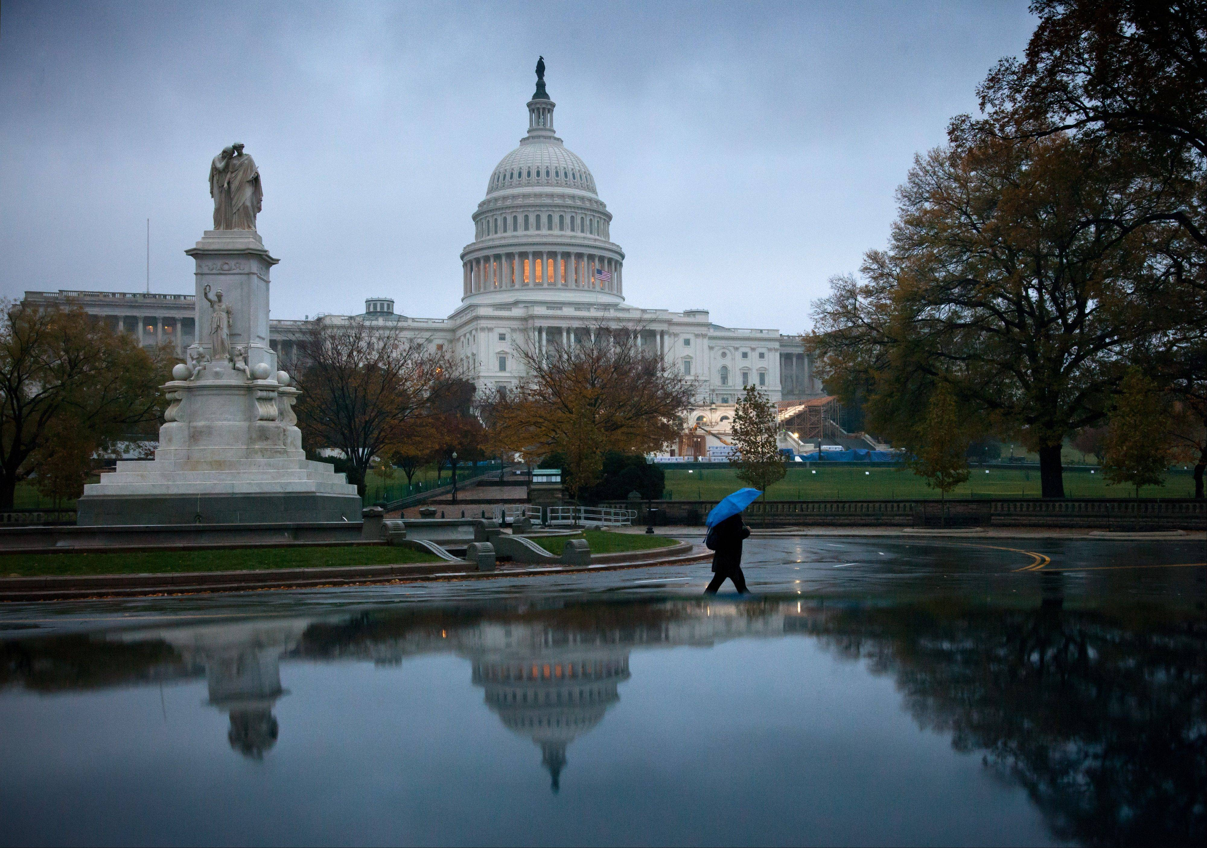 After a seven-week pause, Congress returns Tuesday to a crowded agenda of unfinished business overshadowed by the urgent need for President Barack Obama and lawmakers to avert the economic double hit of tax increases and automatic spending cuts, at the Capitol in Washington, Tuesday, Nov. 13, 2012.