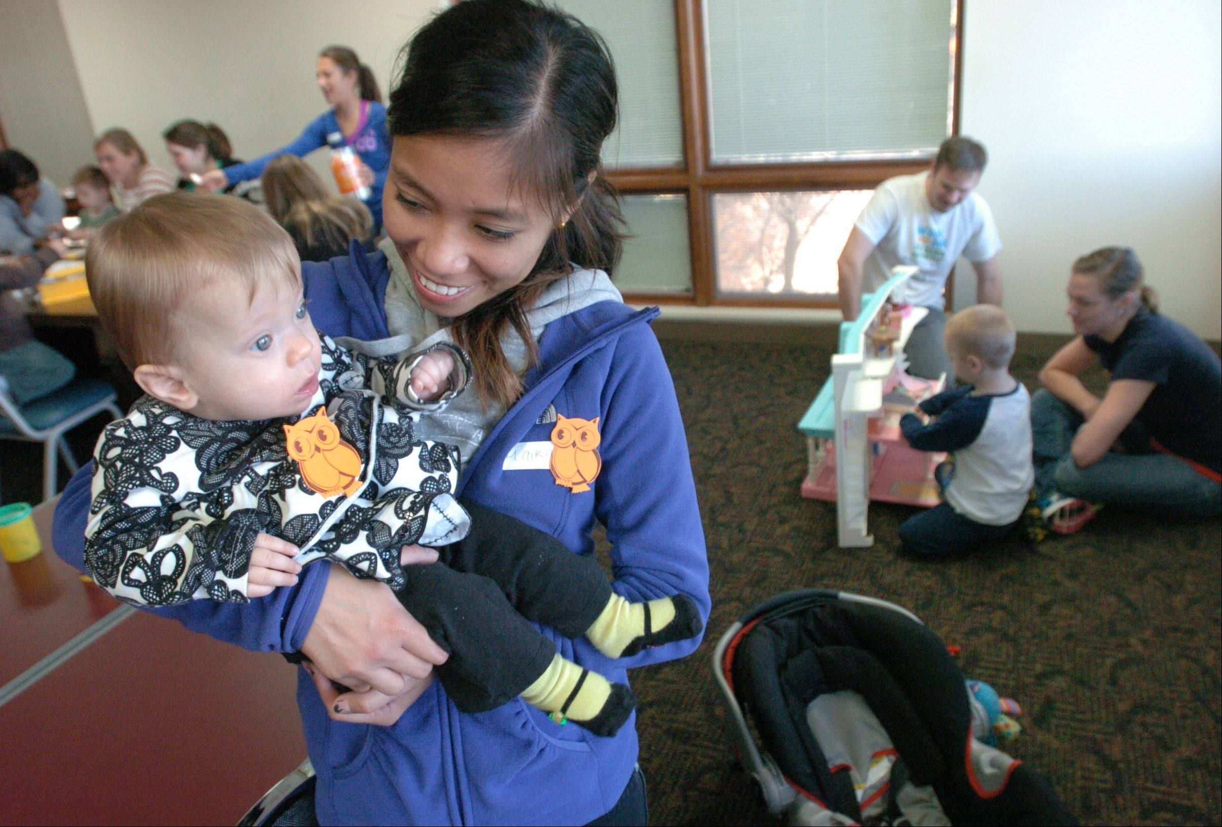 Maika Manalastas holds 10-month-old Lilly Myra of Glendale Heights during DuPage County's new Take a Break in the Afternoon program sponsored by Clearbrook, an Arlington Heights nonprofit organization that serves children and adults with intellectual and developmental disabilities.
