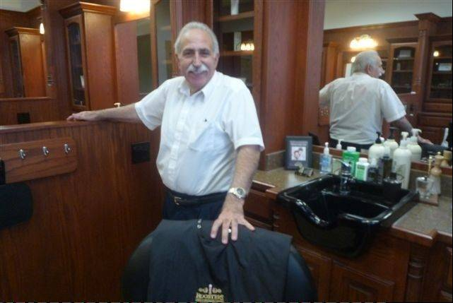 When you start shaving as a 10-year-old, you can grow a first-class mustache such as the one sported by master barber Paul Mirandola at Roosters Men's Grooming Center in Schaumburg.
