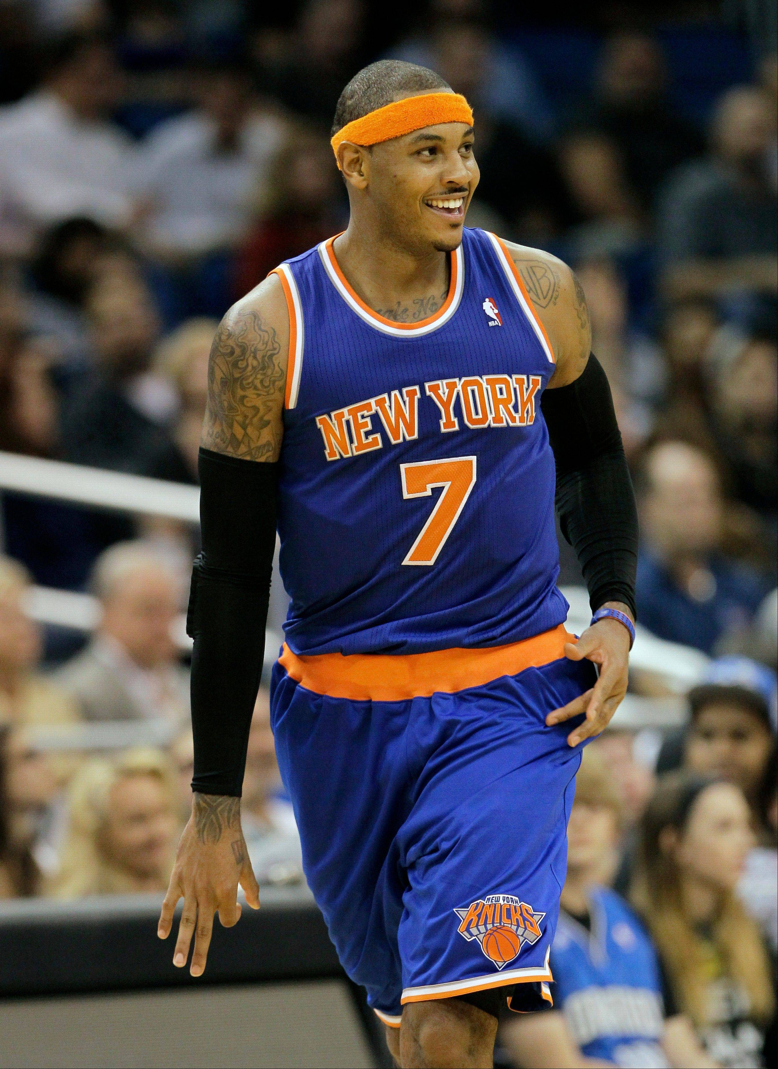New York Knicks forward Carmelo Anthony holds out three fingers on his hand hitting a 3-pointer against the Orlando Magic Tuesday during the fourth quarter in Orlando, Fla. The Knicks won 99-89. Anthony scored 25 points.