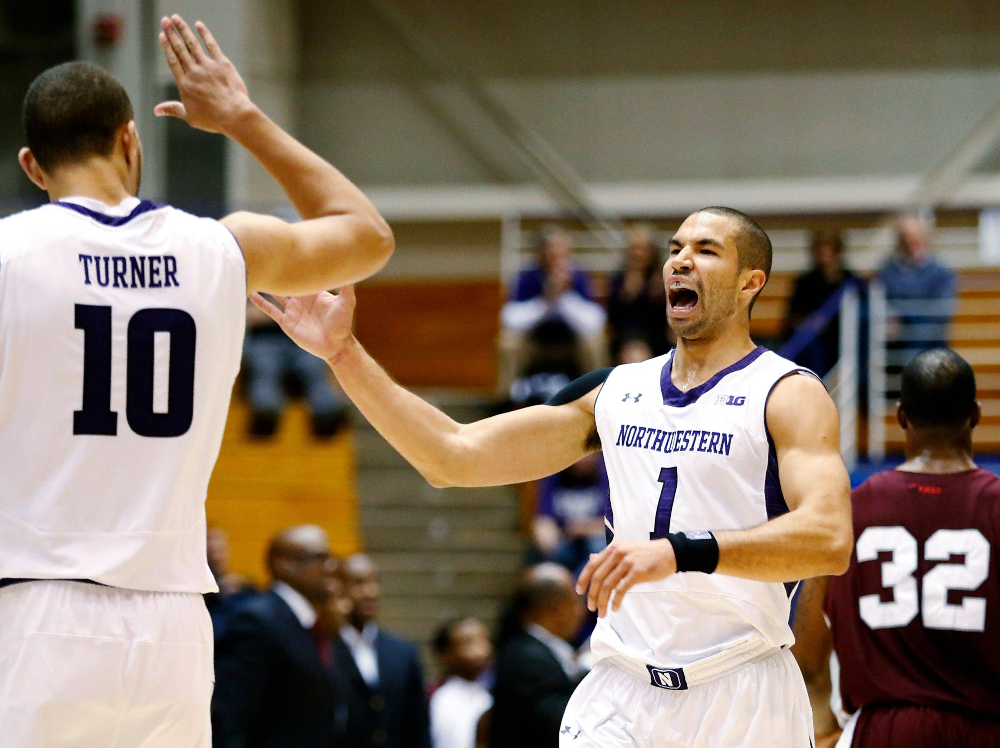 Northwestern's Drew Crawford (1) celebrates with Mike Turner (10) Tuesday after scoring against Texas Southern during the first half in Evanston.