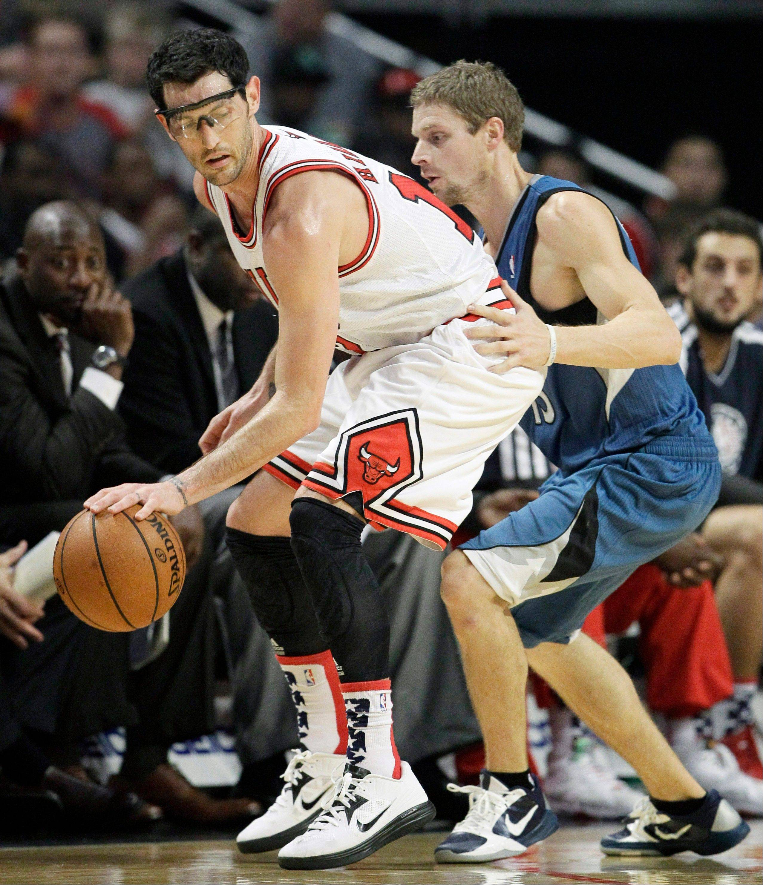 Bulls guard Kirk Hinrich controls the ball as Minnesota Timberwolves guard Luke Ridnour guards Saturday at the United Center. Hinrich sat out Monday night's loss to Boston.