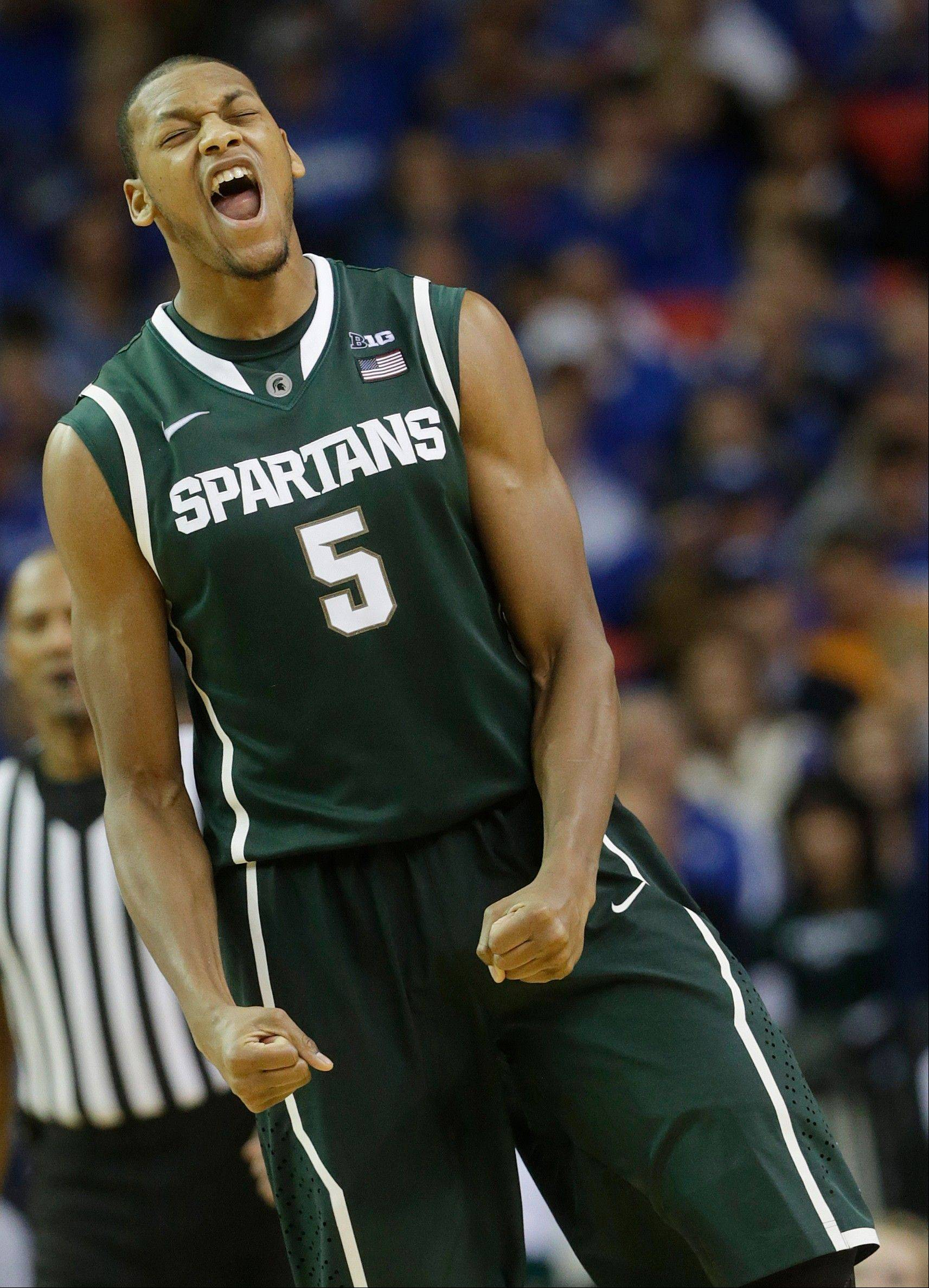 Michigan State center Adreian Payne reacts Tuesday during the second half of the Spartans game against Kansas at the Georgia Dome in Atlanta. Michigan State beat Kansas 67-64.