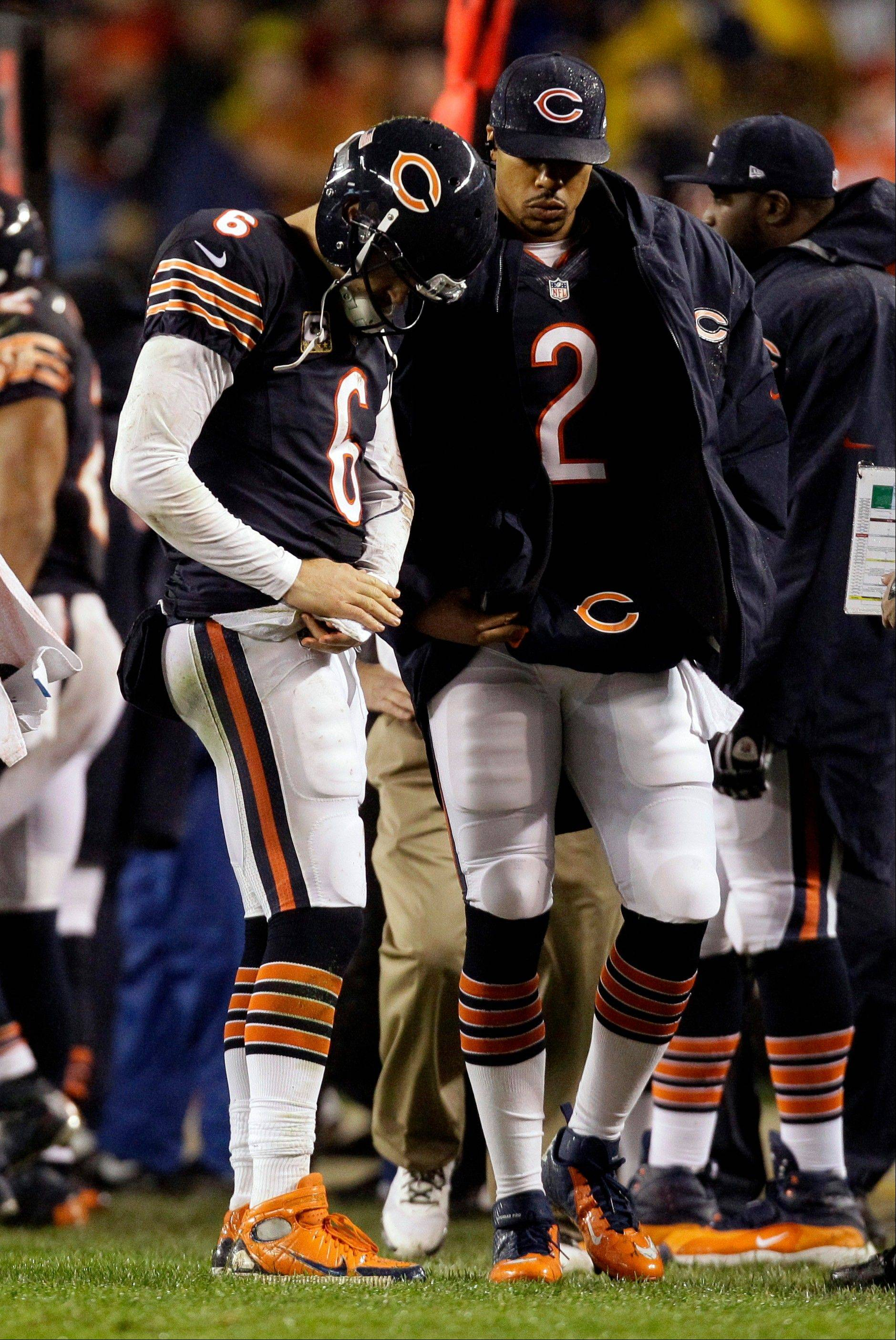 Bears quarterback Jay Cutler talks with backup quarterback Jason Campbell (2) after Cutler took a late hit from Houston linebacker Tim Dobbins in the first half of Sunday's 13-6 loss to the Texans.