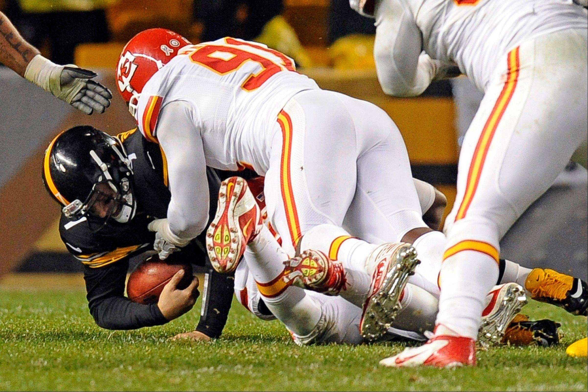 Pittsburgh Steelers quarterback Ben Roethlisberger is sacked by Kansas City Chiefs outside linebacker Tamba Hali (91) Monday during the third quarter in Pittsburgh. Roethlisberger left the game with a right shoulder injury.