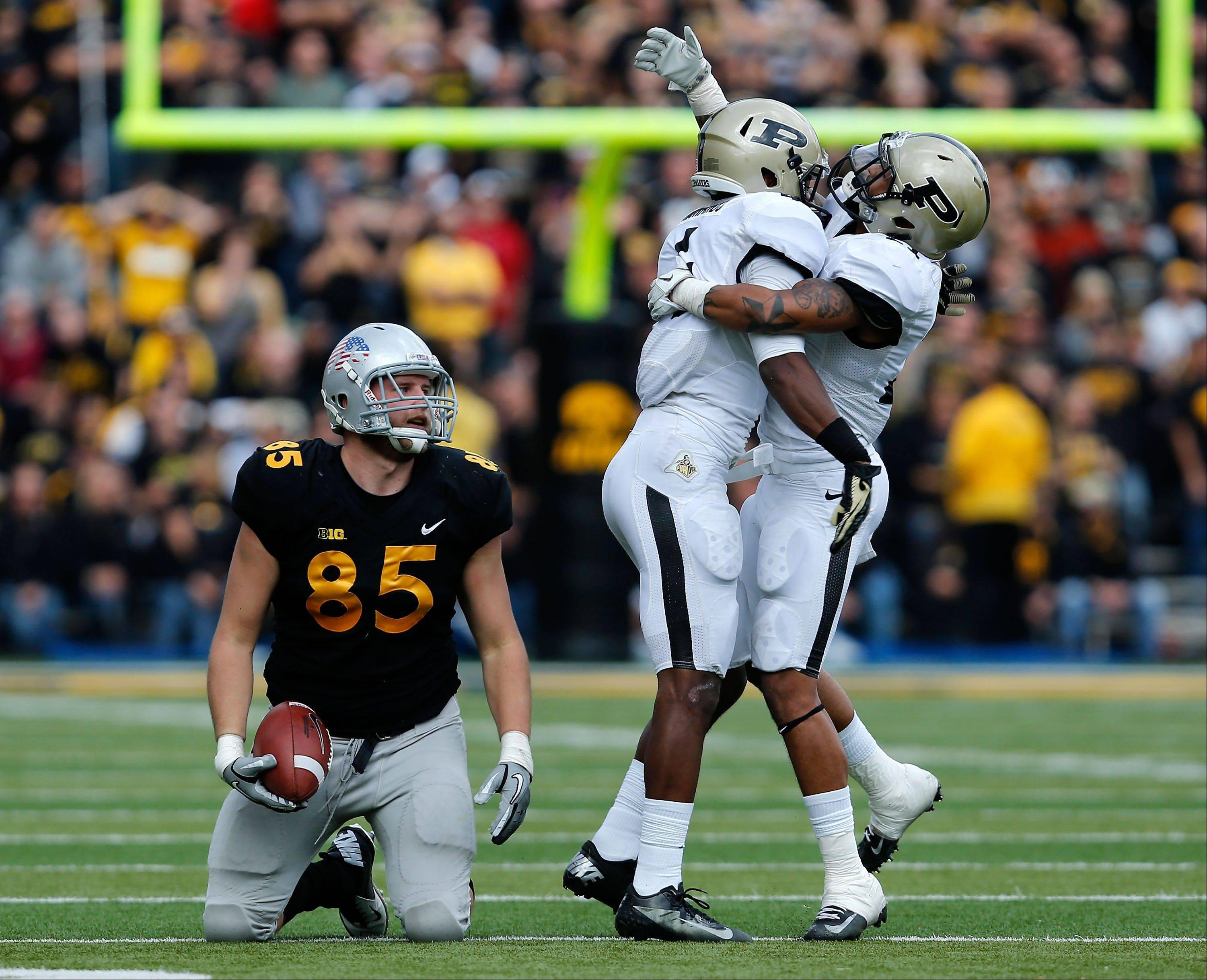 Purdue defensive back Taylor Richards (4) and cornerback Ricardo Allen (21) celebrate after stopping Iowa tight end Zach Derby short of a first down on fourth and three late in the fourth quarter Saturday in Iowa City, Iowa. Purdue won 27-24.