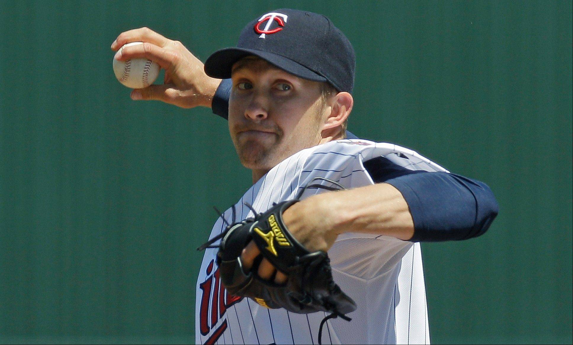 After a seven-year career with the Minnesota Twins that ended with Tommy John surgery on his right elbow last spring, starter Scott Baker has signed a one-year deal with the Cubs worth $5.5 million with incentives that could push it to $7 million.