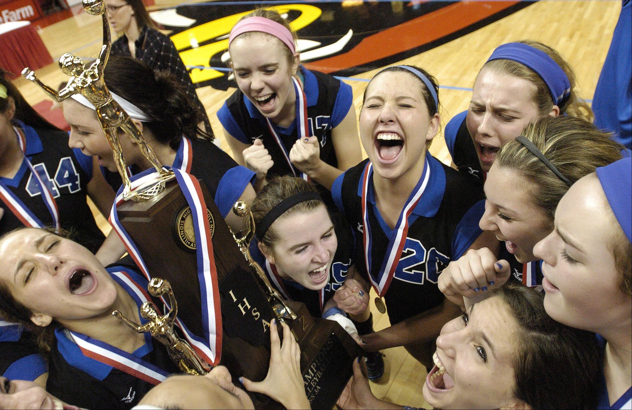 St. Francis players celebrate their Class 3A state volleyball win Saturday.