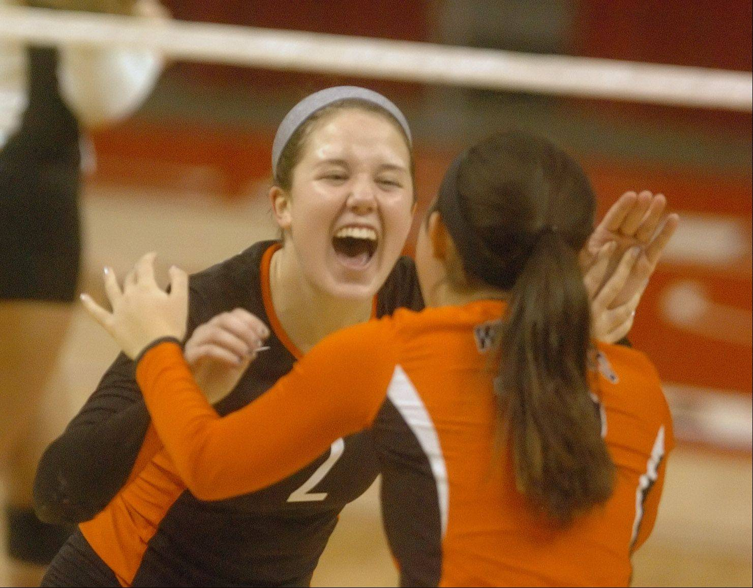 Kristen Webb, left, and Brooke Donovan celebrate during the class 4A girls volleyball semifinal Friday.