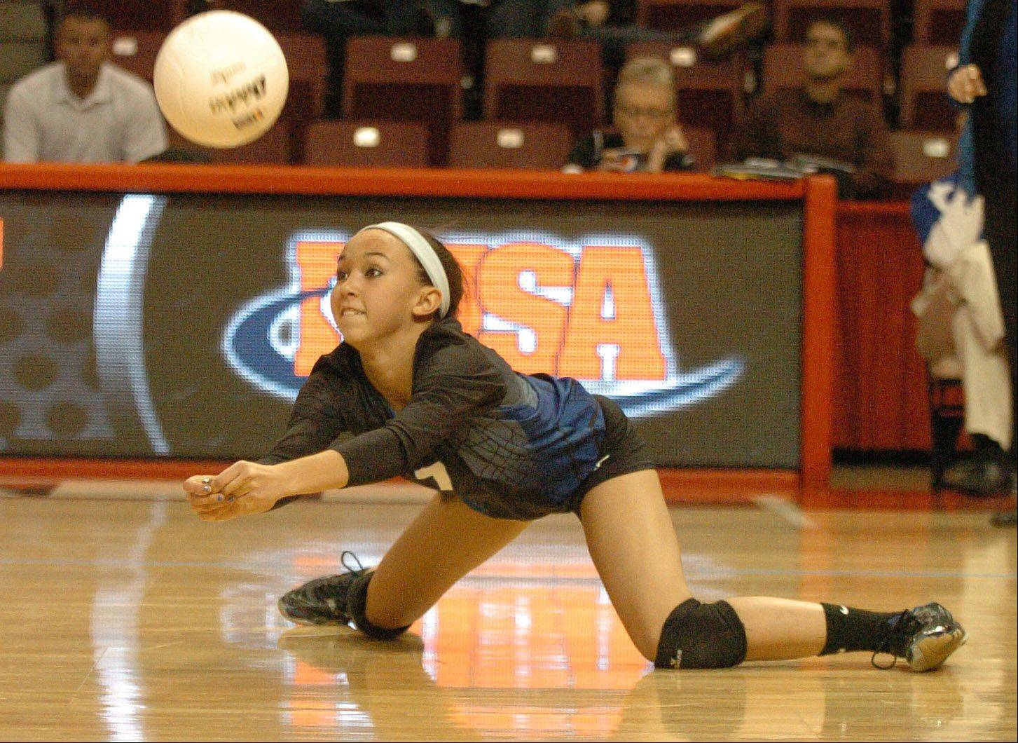 St. Francis' Natalie Murison dives for the ball during the class 3A state semifinal against Champaign Centennial.