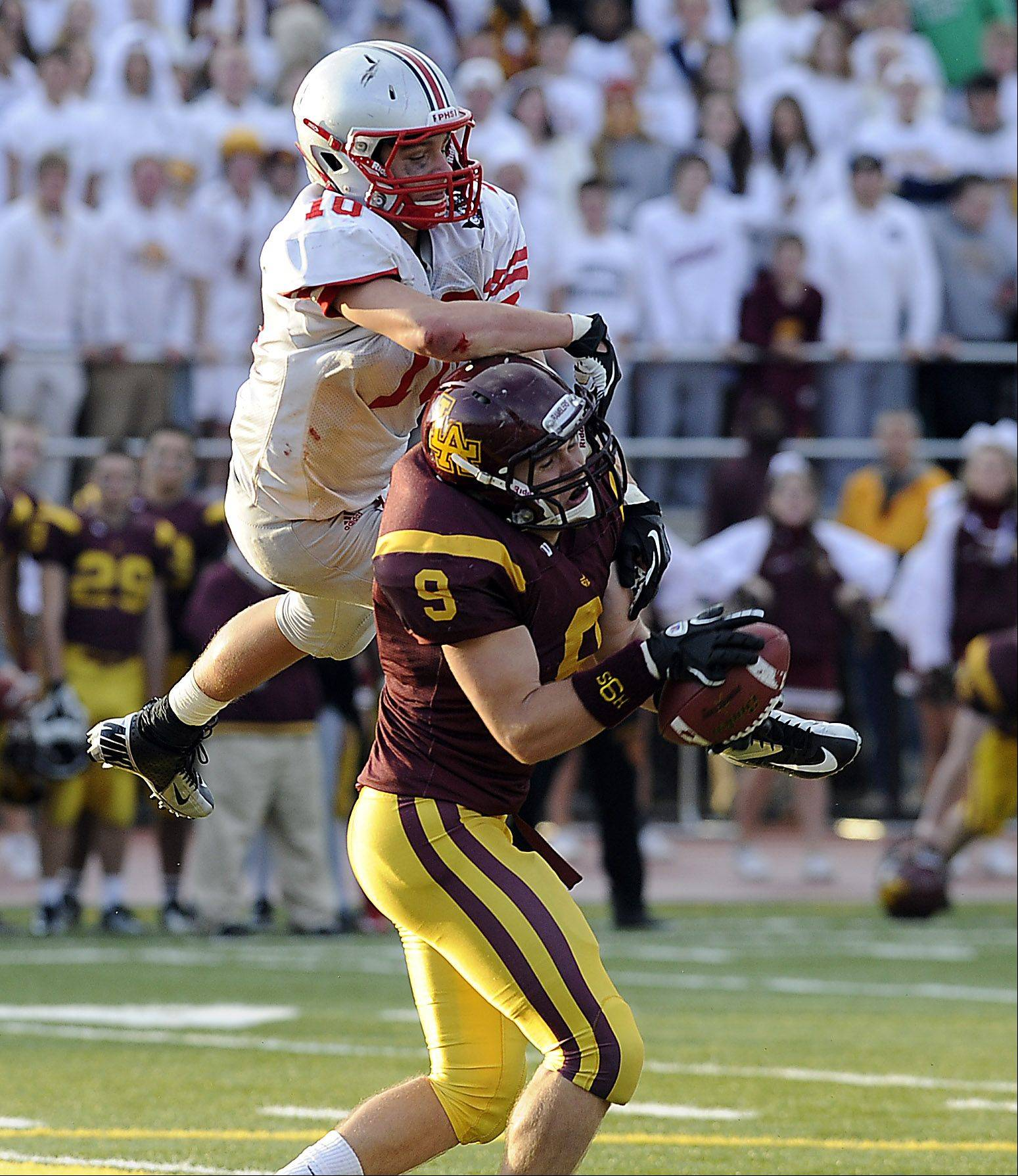 Palatine's Cam Kuksa loses the ball in this interception by Loyola's Cody Sullivan at the Class 8A playoff quarterfinals Saturday.