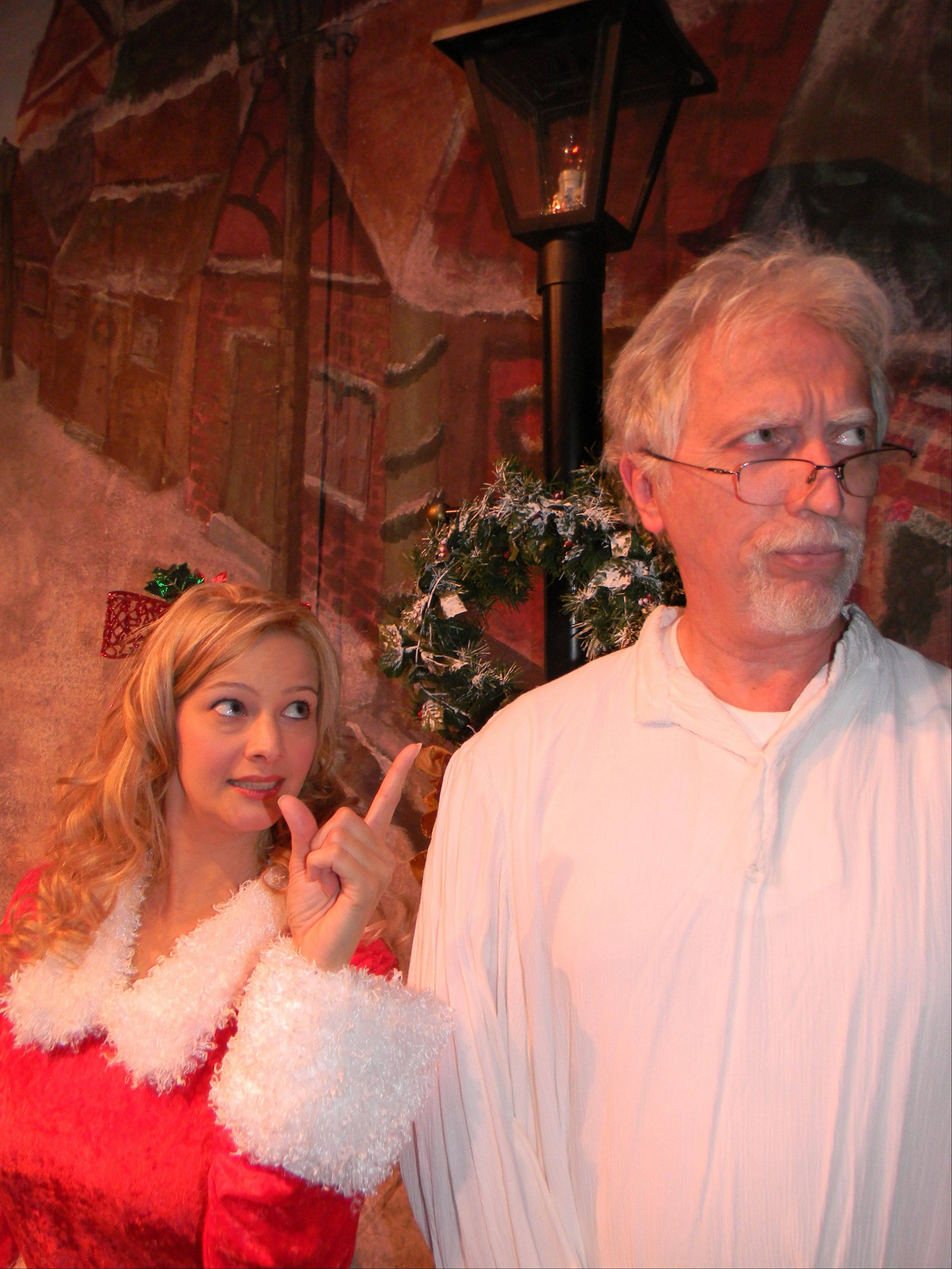 "Julie Bayer of Naperville as Christmas past, and Steve Connell of Crystal Lake as Scrooge will perform in ""Scrooge the Musical"" at Steel Beam Theatre on Nov. 17-Dec. 23."