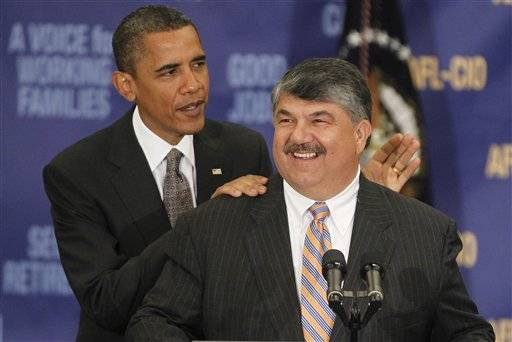 ile- This Aug. 4, 2010 file photo shows President Barack Obama standing with AFL-CIO Presidet Richard Trumka after he spoke about jobs and the economy at the AFL-CIO Executive Council in Washington.