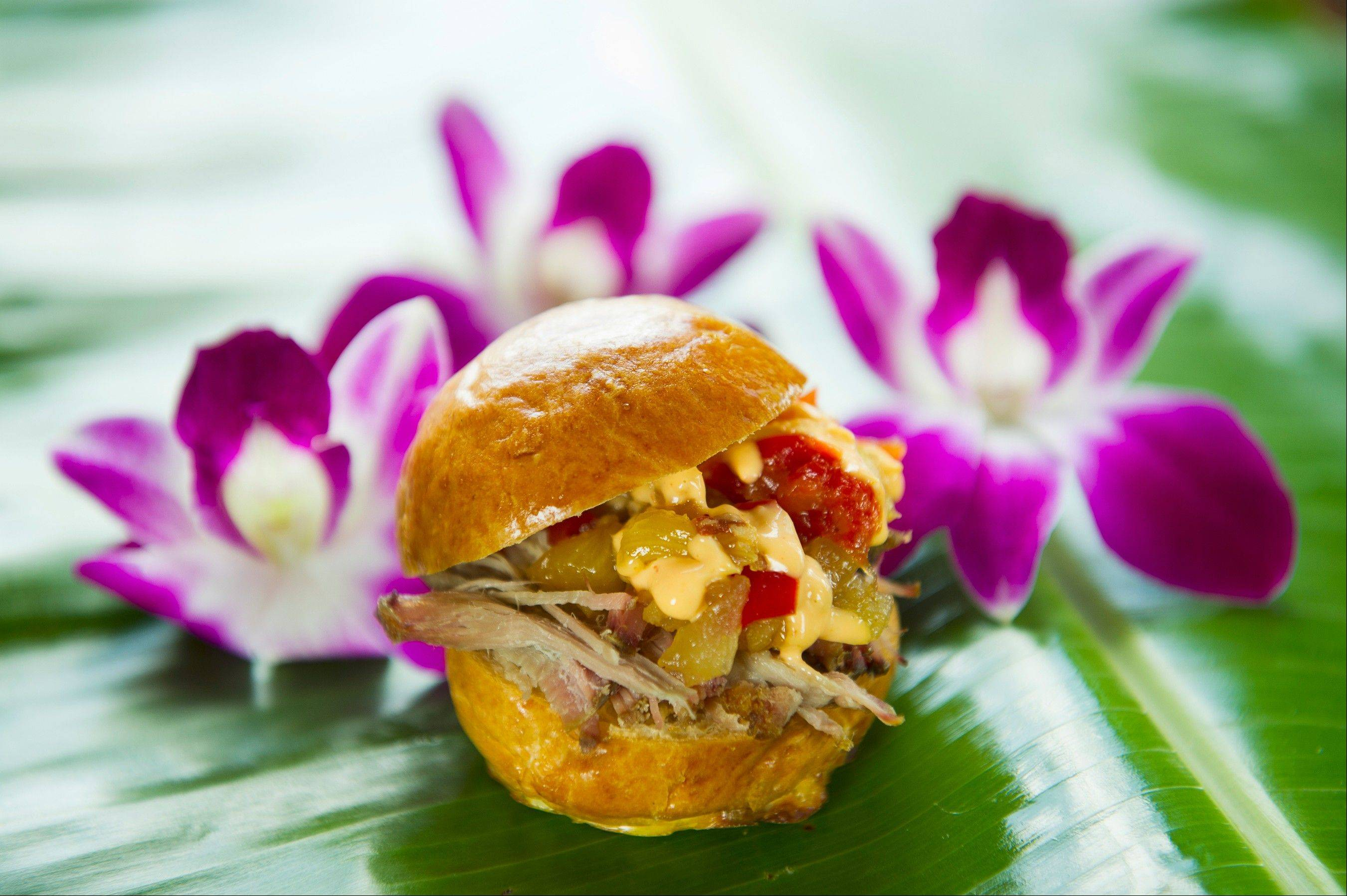 The Kalua Pork Slider (not the liqueur Kahlua but the Kalua barbecue method of cooking) returns to the Hawaii tasting marketplace at the Epcot International Food & Wine Festival running Sept. 28-Nov. 12 at Walt Disney World Resort in Lake Buena Vista, Fla. (Matt Stroshane, photographer)