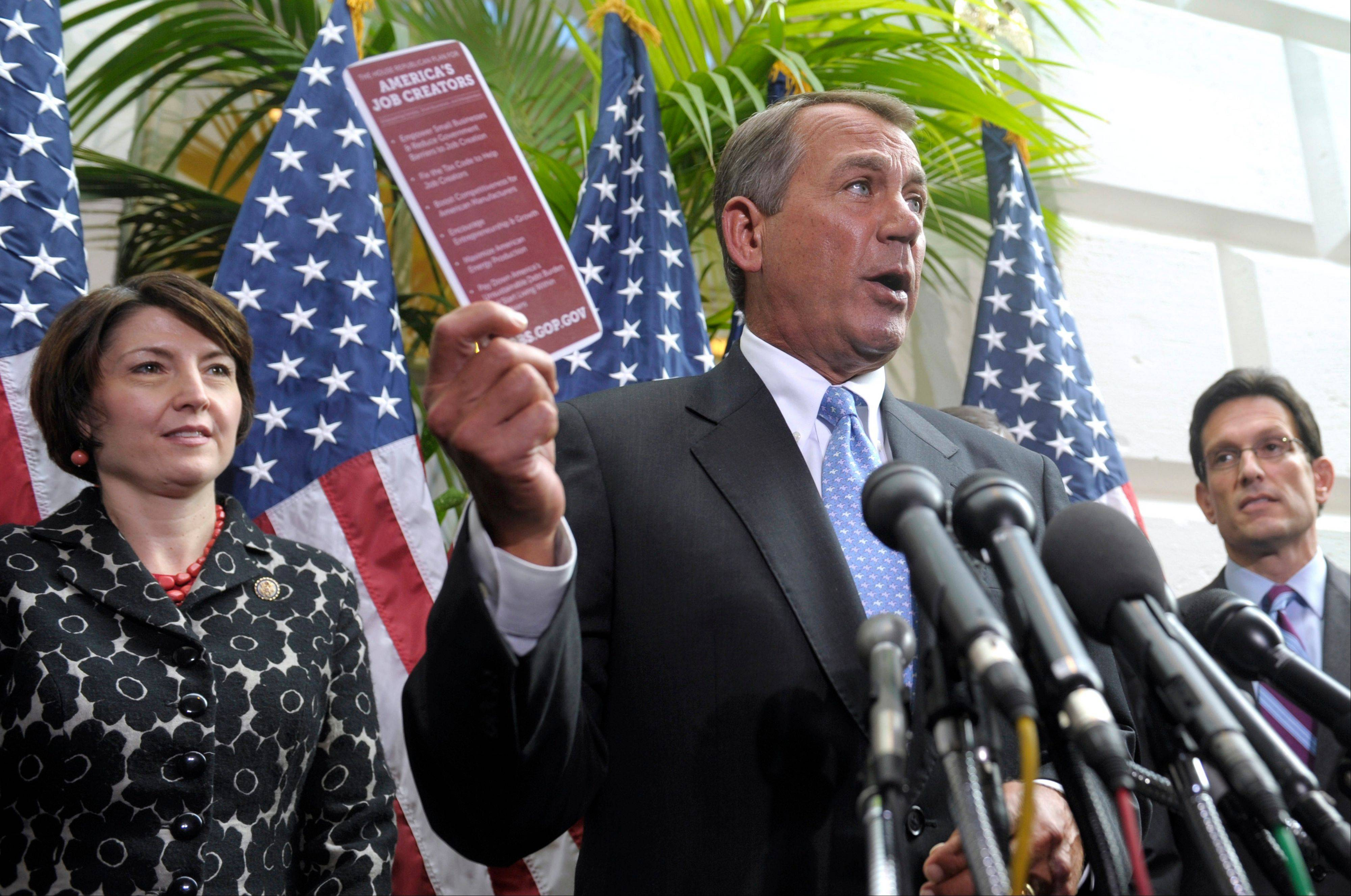 In this photo from November 2011, Rep. Cathy McMorris Rodgers is seen at left as House Speaker John Boehner speaks and House Majority Leader Eric Cantor listens. Rodgers was voted to the No. 4 leadership position among House Republicans on Wednesday.