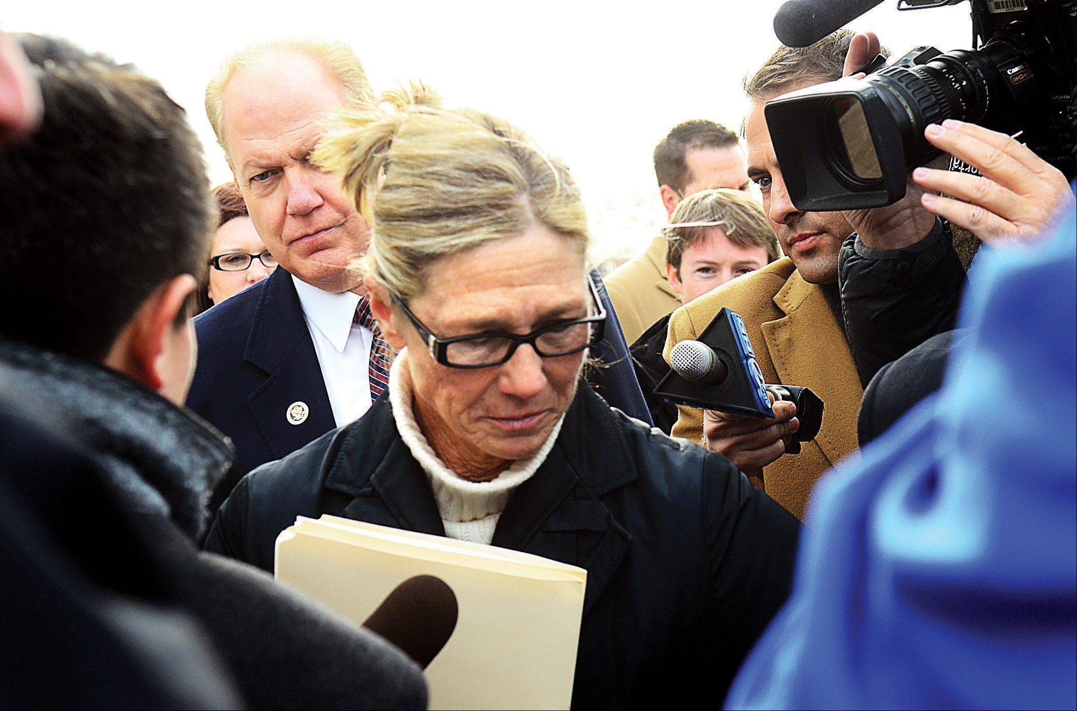 Rita Crundwell walks pass the media outside of the federal courthouse in Rockford on Wednesday. The former comptroller of Dixon, she pleaded guilty to allegations she embezzled more than $50 million from the small city to fund a lavish lifestyle.