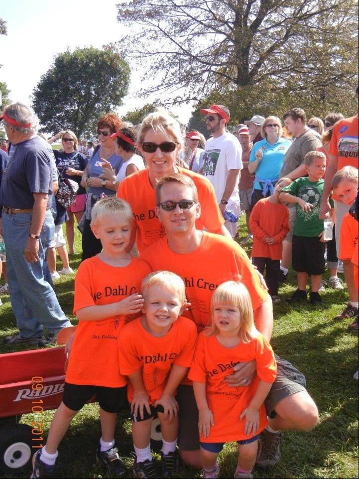 Eric and Jean Dahl with their children, Gunnar, 8; Andrew, 6; and Julia, 3, at the Les Turner ALS Walk4Life. Friends, family and co-workers will gather Saturday to celebrate Eric�s 41st birthday and raise money to buy the family a customized van.