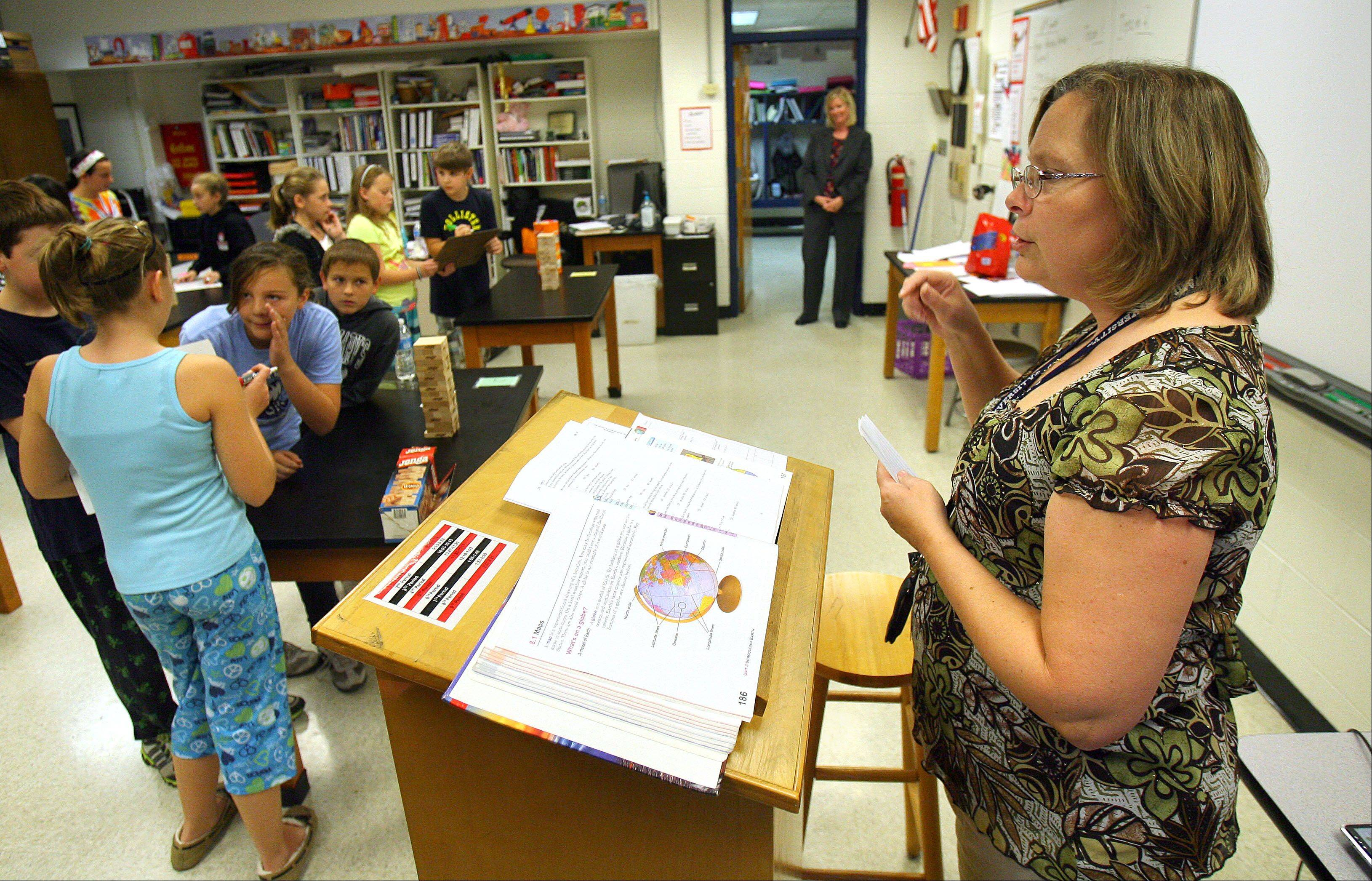 Sixth-grade science teacher Sharon Page conducts a science game at Emmons School in Antioch. Its teachers have the lowest average salaries among 91 suburban districts reviewed by the Daily Herald.