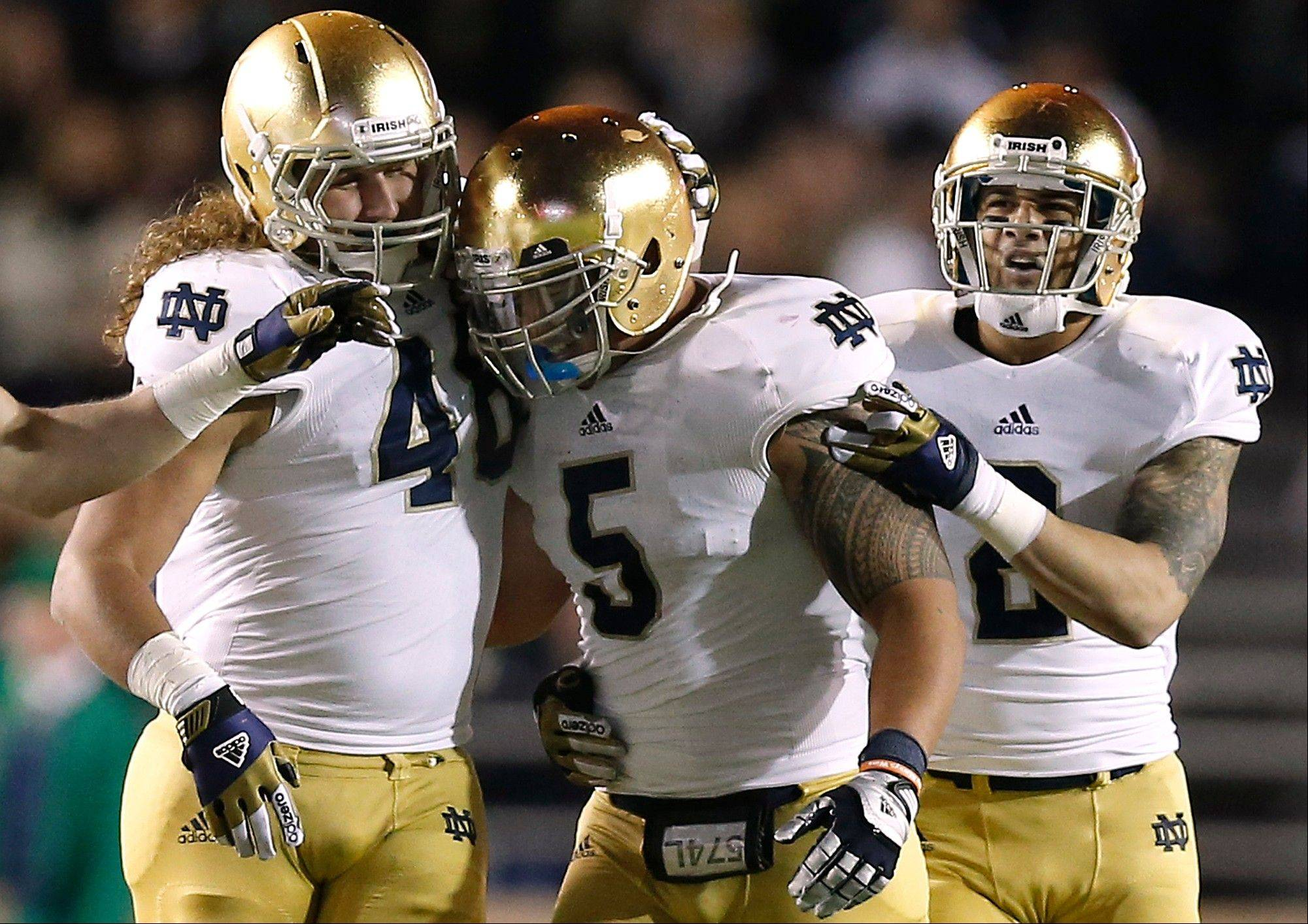 Notre Dame linebacker Manti Te�o is congratulated by teammates Dan Fox and Bennett Jackson, right, after his interception Saturday during the second half of Notre Dame�s 21-6 win over Boston College in Boston. Te�o will play at Notre Dame Stadium for the final time Saturday, giving Fighting Irish fans the chance to celebrate one of the best linebackers in the history of the storied program and thank him for leading the team to one of its best seasons in decades.
