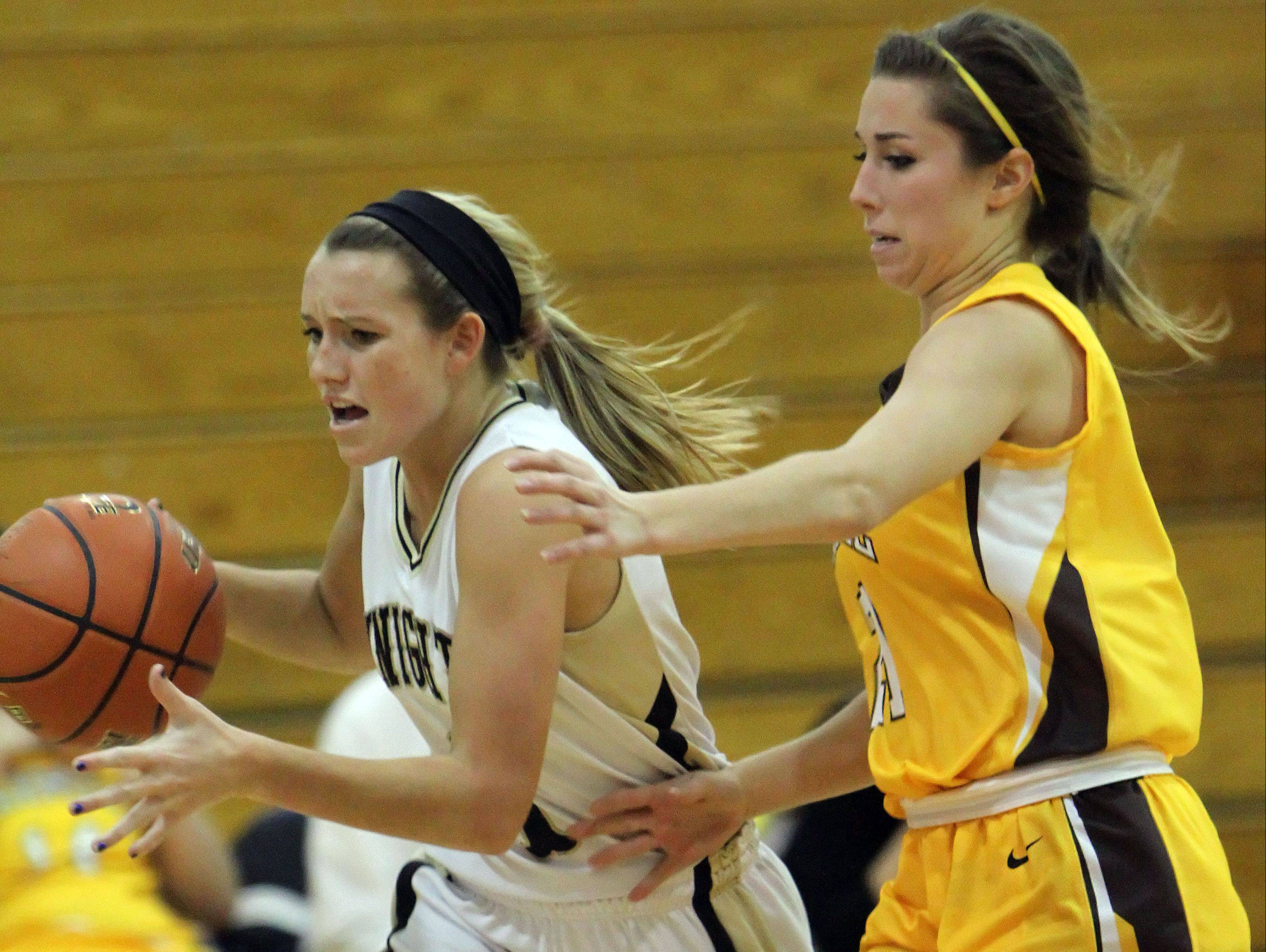 Grayslake North's Jordyn Bowen, left, drives on Carmel's Nicole Bitter during the Mundelein High School Turkey Tournament on Wednesday.