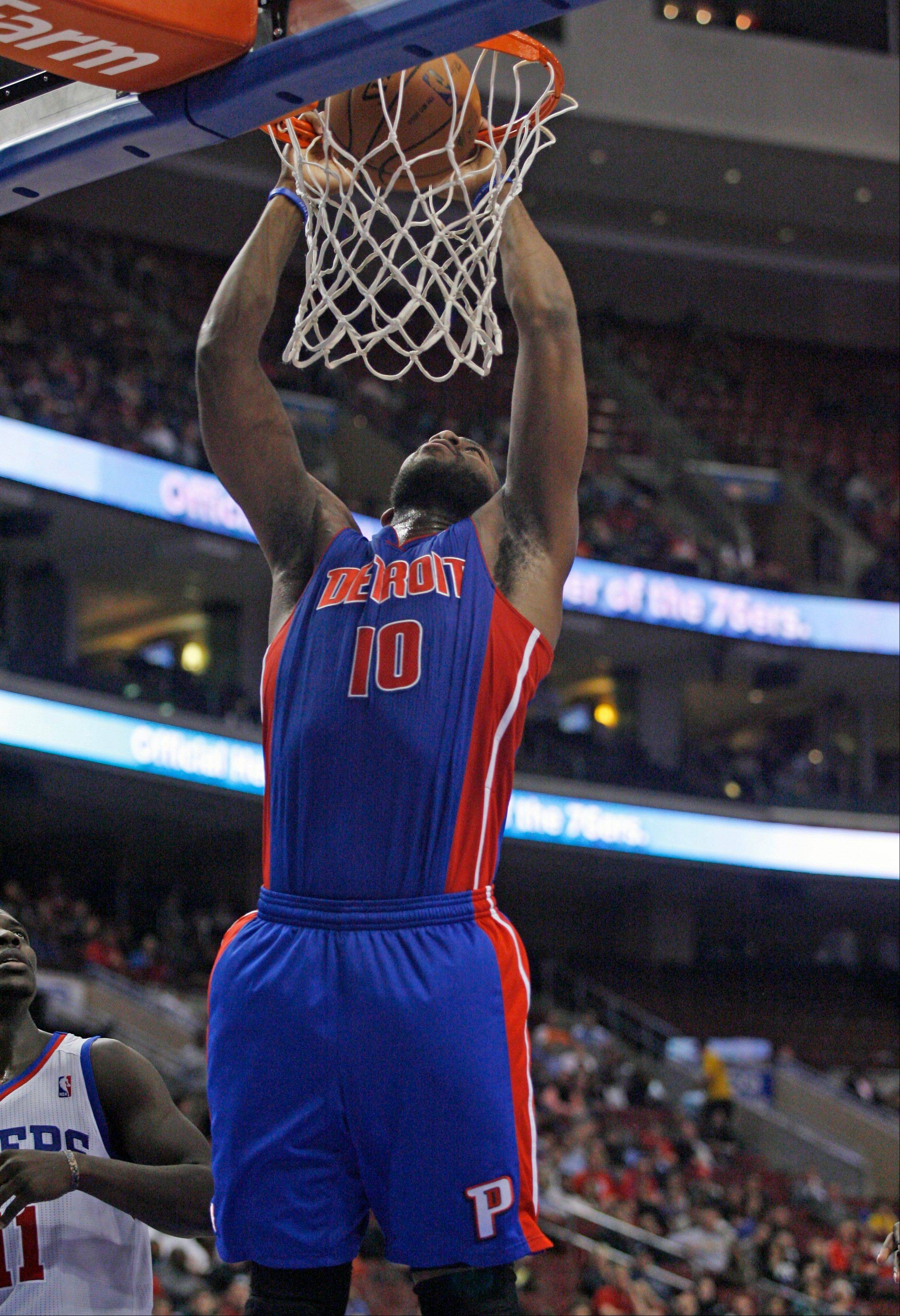 The Detroit Pistons' Greg Monroe dunks against the Philadelphia 76ers Wednesday during the first half in Philadelphia.