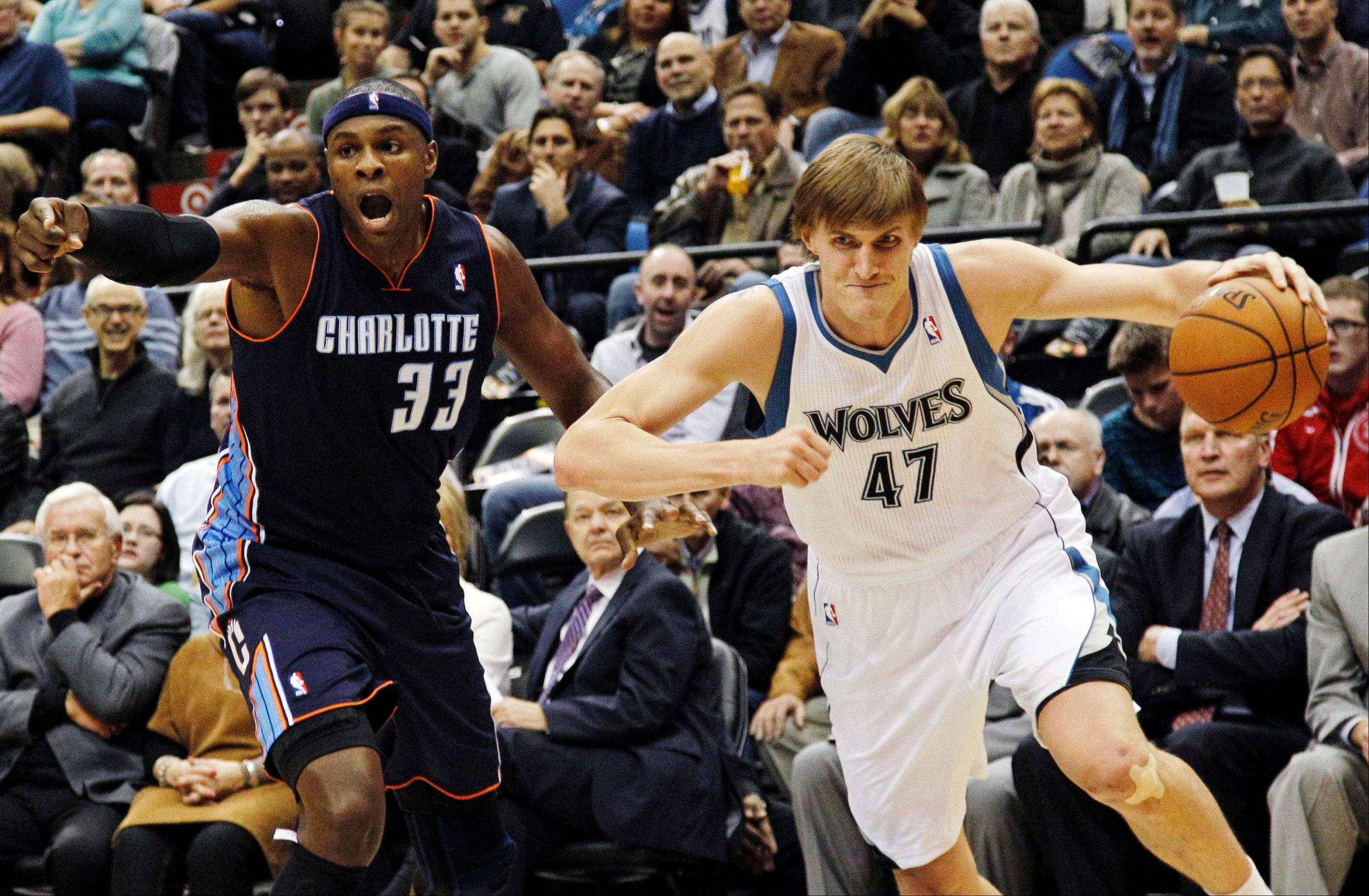 The Minnesota Timberwolves' Andrei Kirilenko drives on the Charlotte Bobcats' Brendan Haywood Wednesday during the first half in Minneapolis.