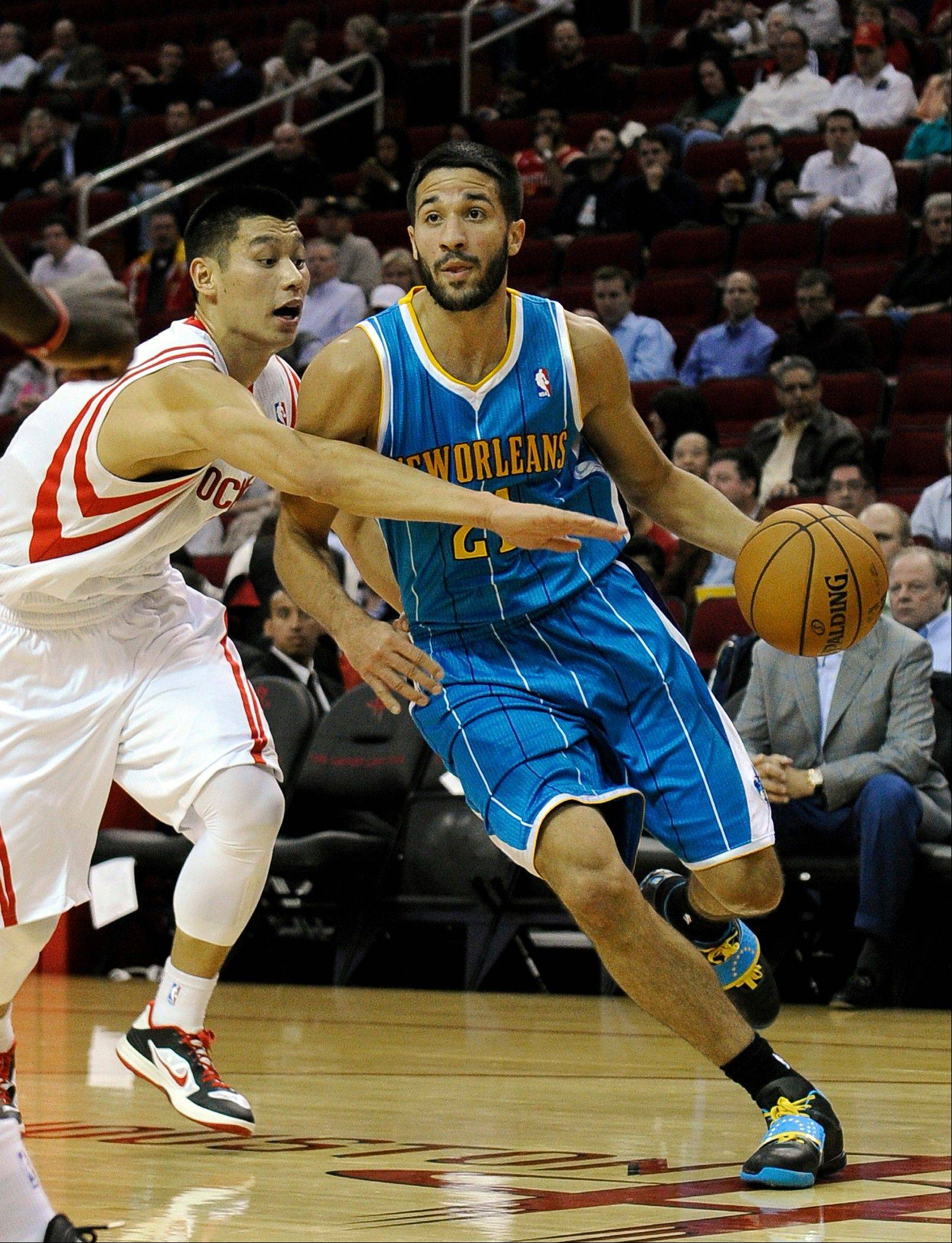 Houston Rockets guard Jeremy Lin reaches for the New Orleans Hornets� Greivis Vasquez Wednesday during the first half in Houston.