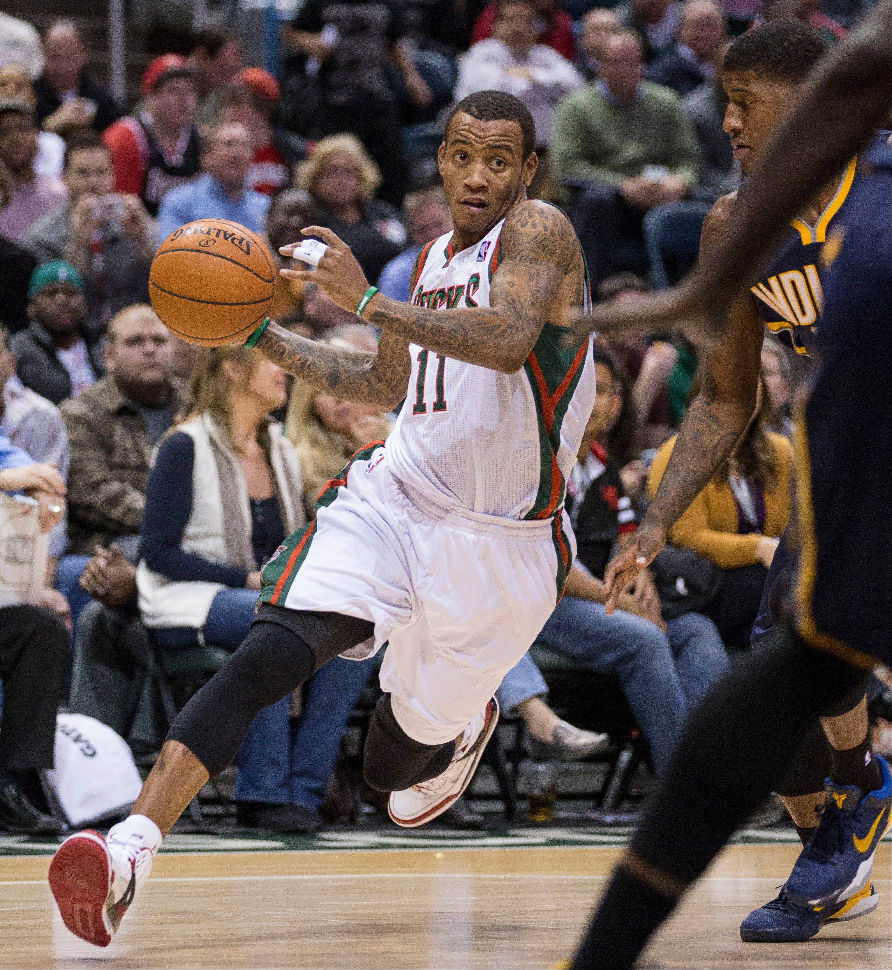 The Milwaukee Bucks' Monta Ellis drives on the Indiana Pacers defense Wednesday during the first half in Milwaukee.