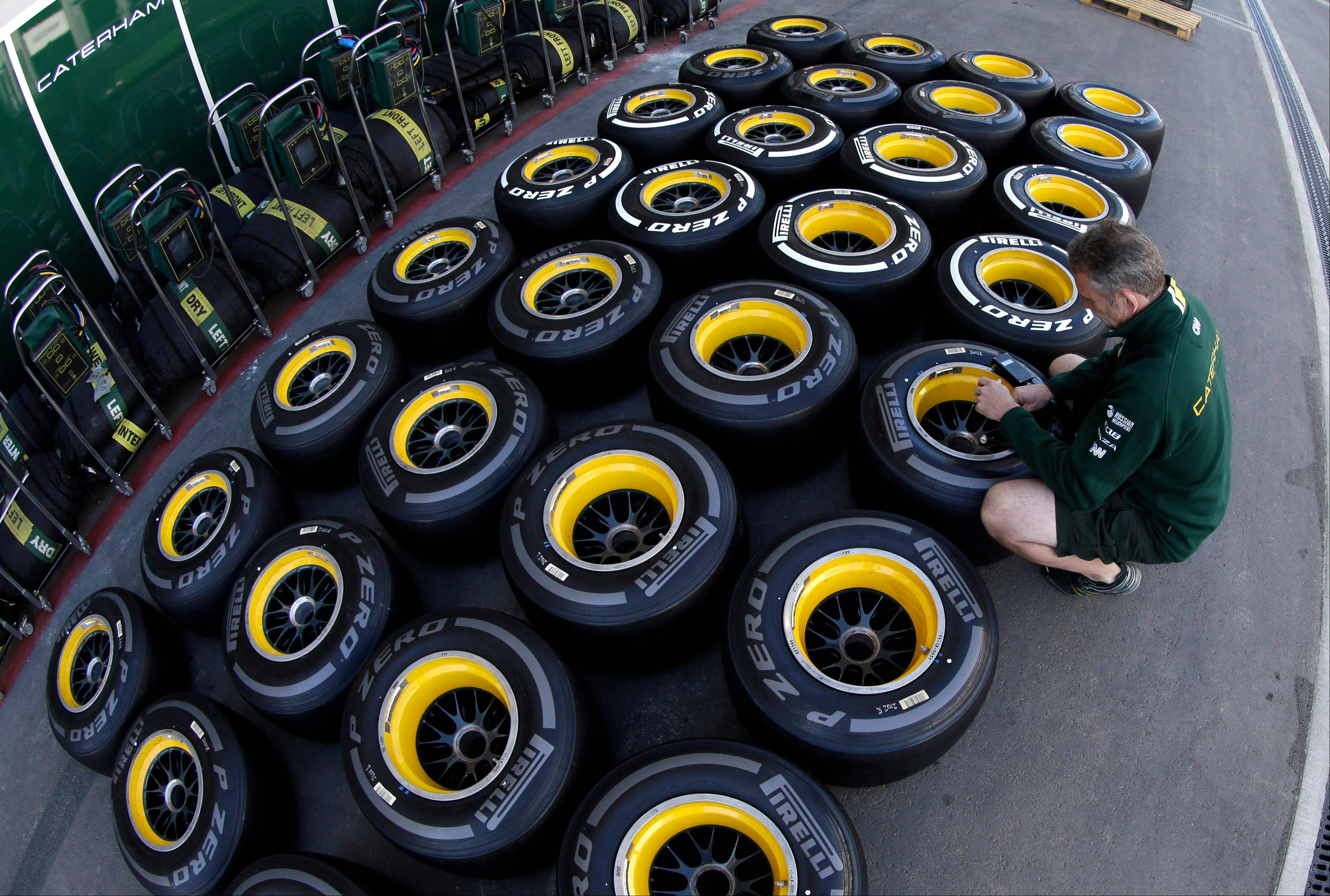 Caterham F1 team technician Barry Mines checks tire pressures at the Circuit of the Americas racetrack in Austin, Texas, on Wednesday.