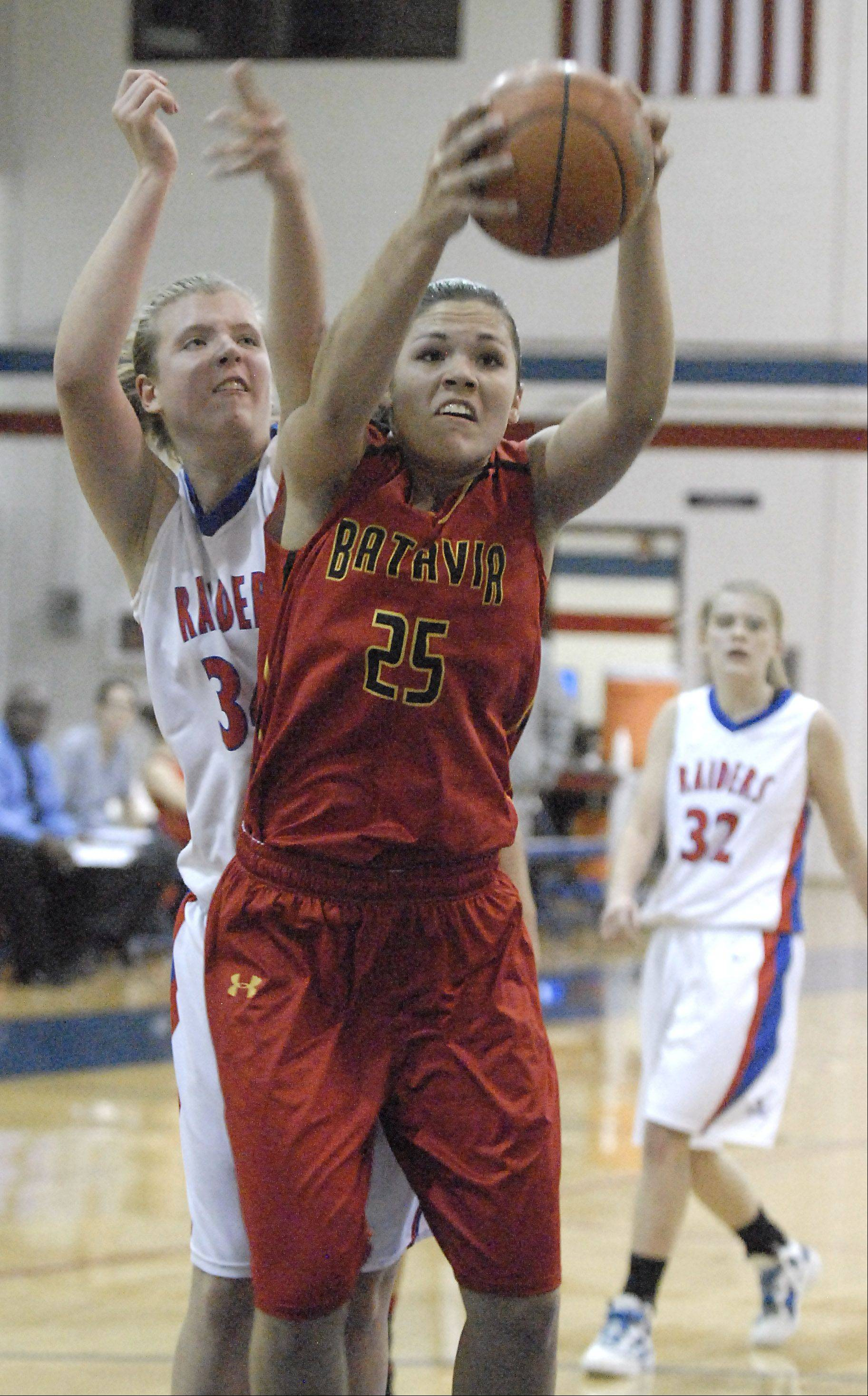Batavia's Hannah Frazier grabs a Raiders rebound in front of Glenbard South's Sydney Bauman in the third quarter on Tuesday, November 13.