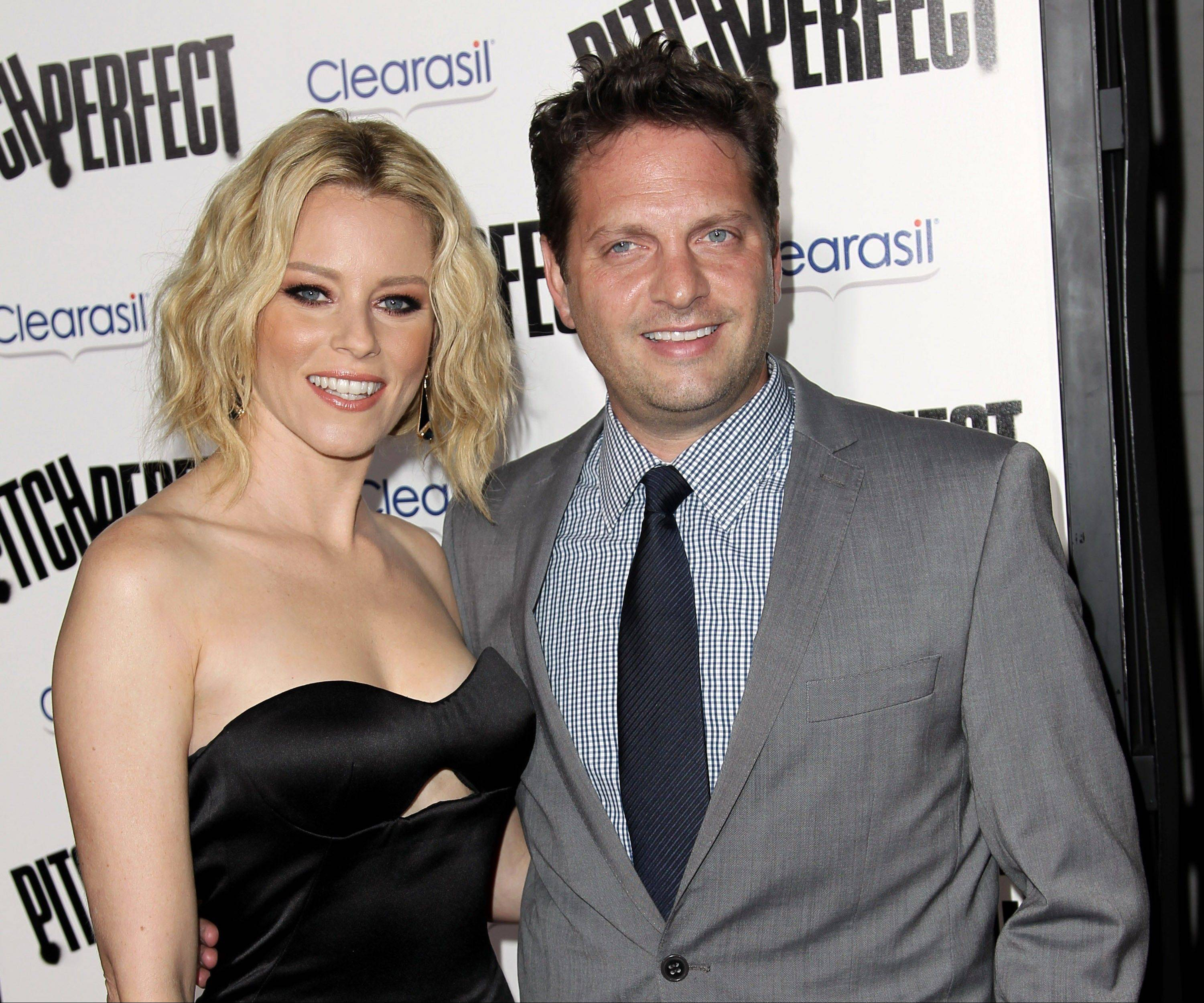 Elizabeth Banks and her husband, Max Handelman, announced the arrival of the couple's second son, Magnus Mitchell Handelman, who was born via gestational surrogate.